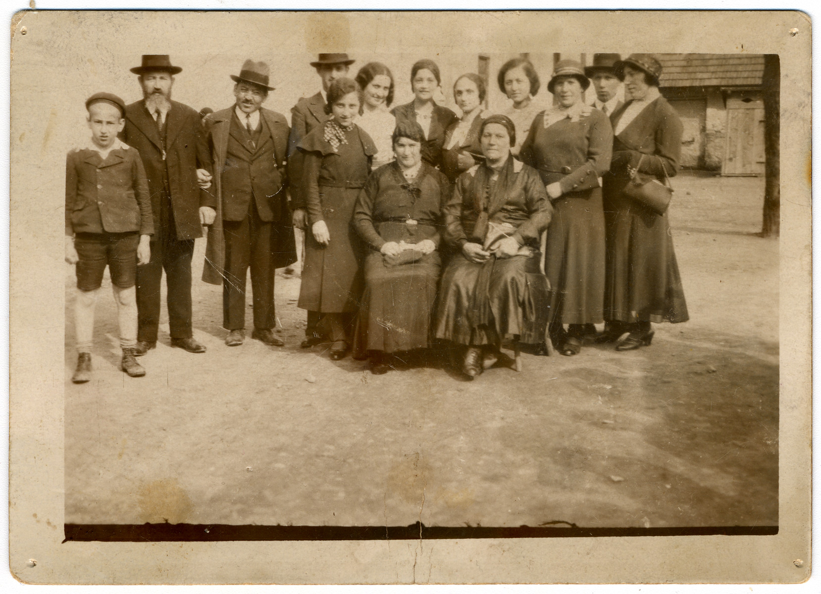 A large Orthodox family gathers together on the Jewish holiday, Lag Ba'Omer.  Seated are: Sharika Frieder (wife of Pinchas Frieder), Mali Grunfeld (Malvina's mother).  Standing are: Walter Jungleib (son of Arye Jungleib and Malvin Frieder, daughter of Pinchas Frieder), Pinchas (Philip) Frieder (cantor and shochet in Prievidze, CZ), Arye Jungleib, (boy in back) cousin to Rabbi Lebovich's daughters, (girl in front) girlfriend of Malvina's from Galanta, daughter of Rabbi Lebovich from Bratislava, ?  Fruchter (sister-in-law to Malvina's sister, Zali), daughter of Rabbi Lebovich from Bratislava, Helen Weinstein (Malvina's sister), Avraham (Rumi) Grunfeld (Malvina's brother, Lenke Grunfeld (Malvina's sister)