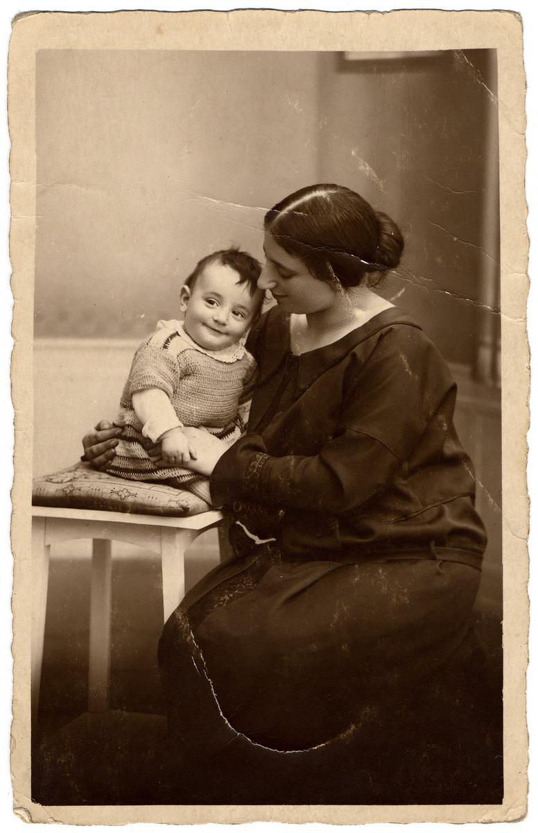 Studio portrait of Margarete Wertheim holding her son Ernst.