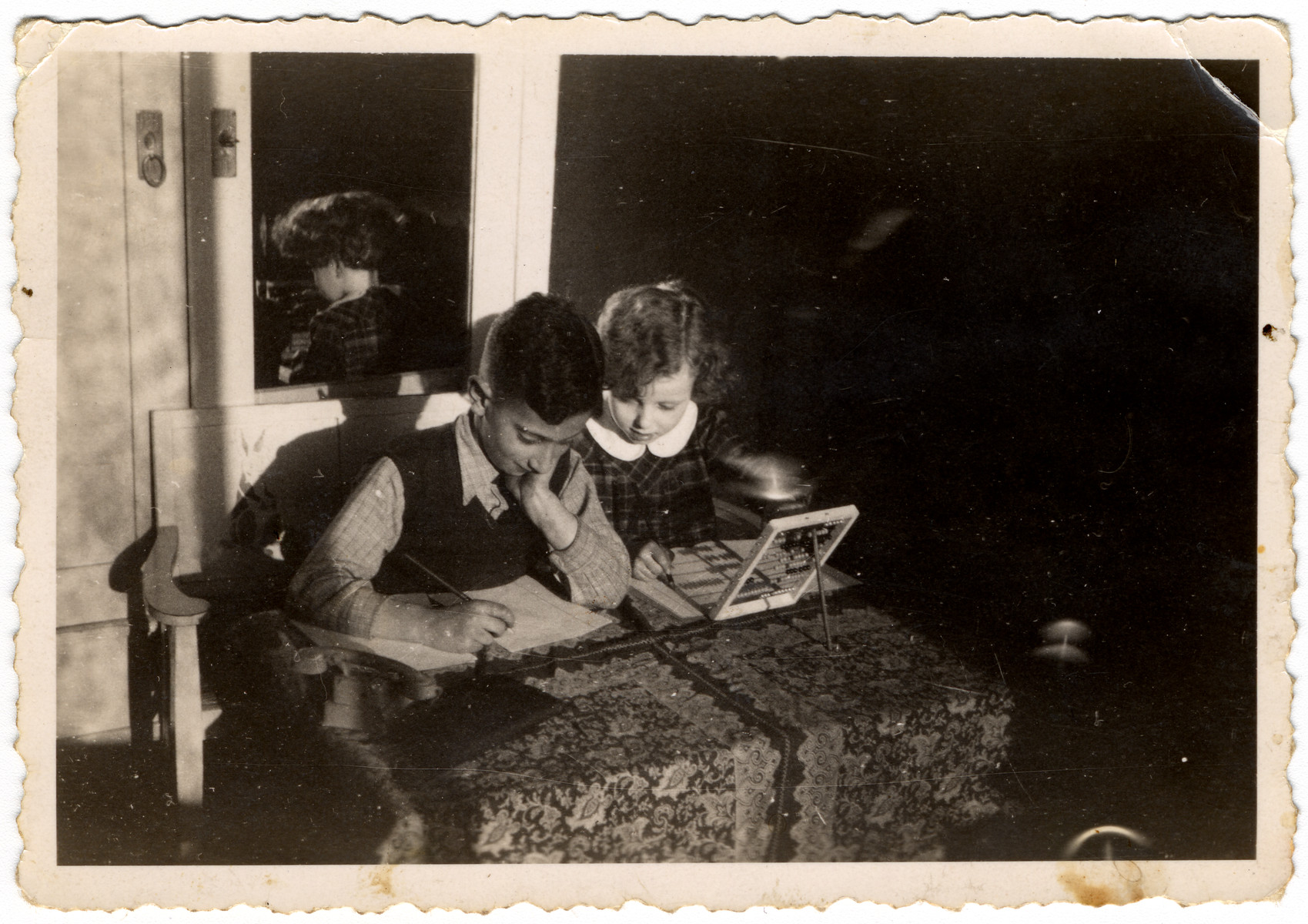 Martin Wertheim and his friend Ana do calculations on an abacus.  The young girl may be be Nana Willinsky.