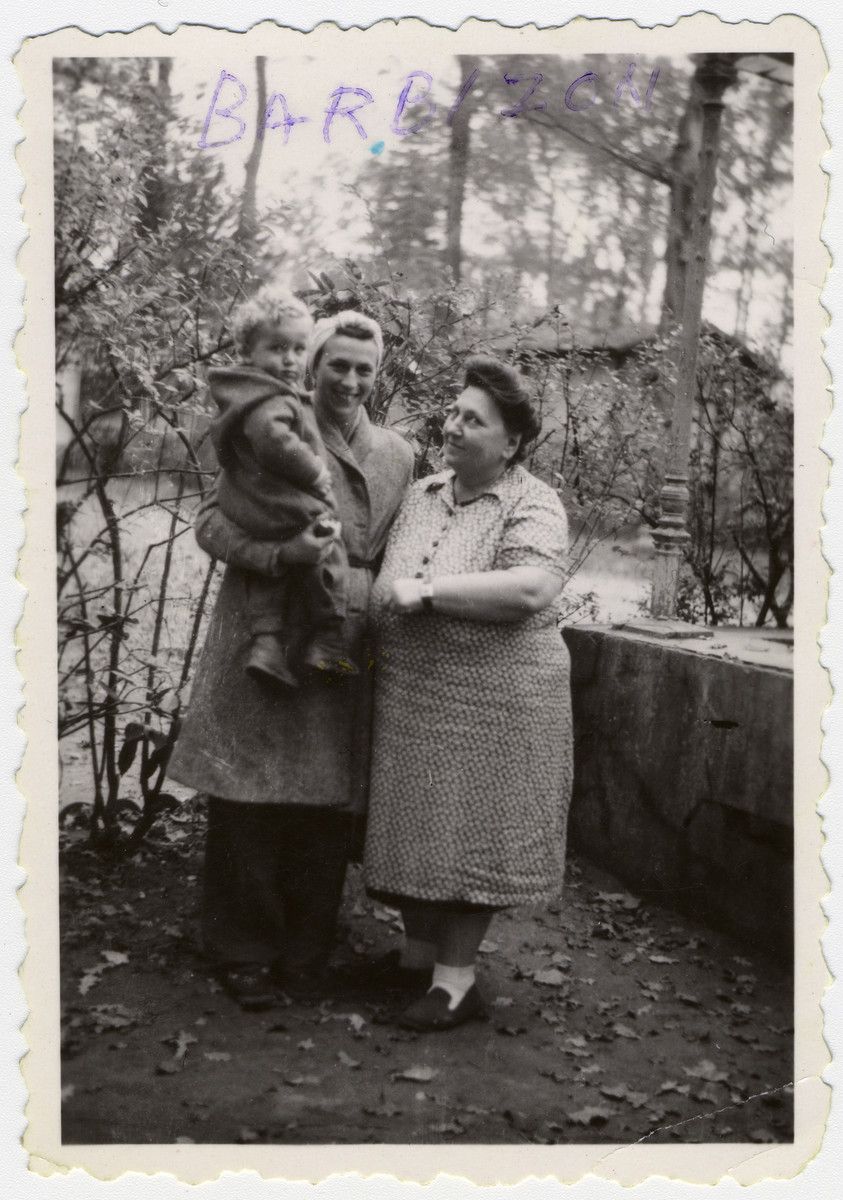 Miriam Rosenthal, holding her son Leslie, poses with the cook at the Barbizon children's home outside of Paris.