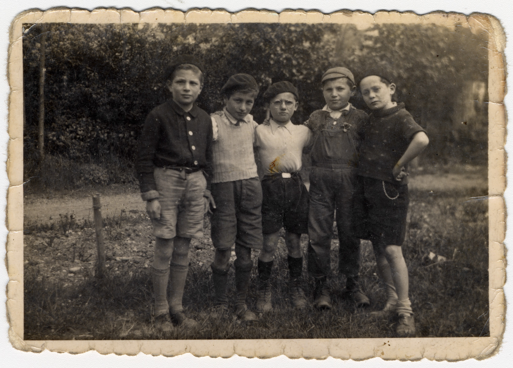 Group portrait of five boys in the Chateau des Morelles childrens' home.    Charles Rosenblat is pictured in the center.  Markus Horowitz may be on the far right. The boy second from the right may be Bernd Boettigheimer.