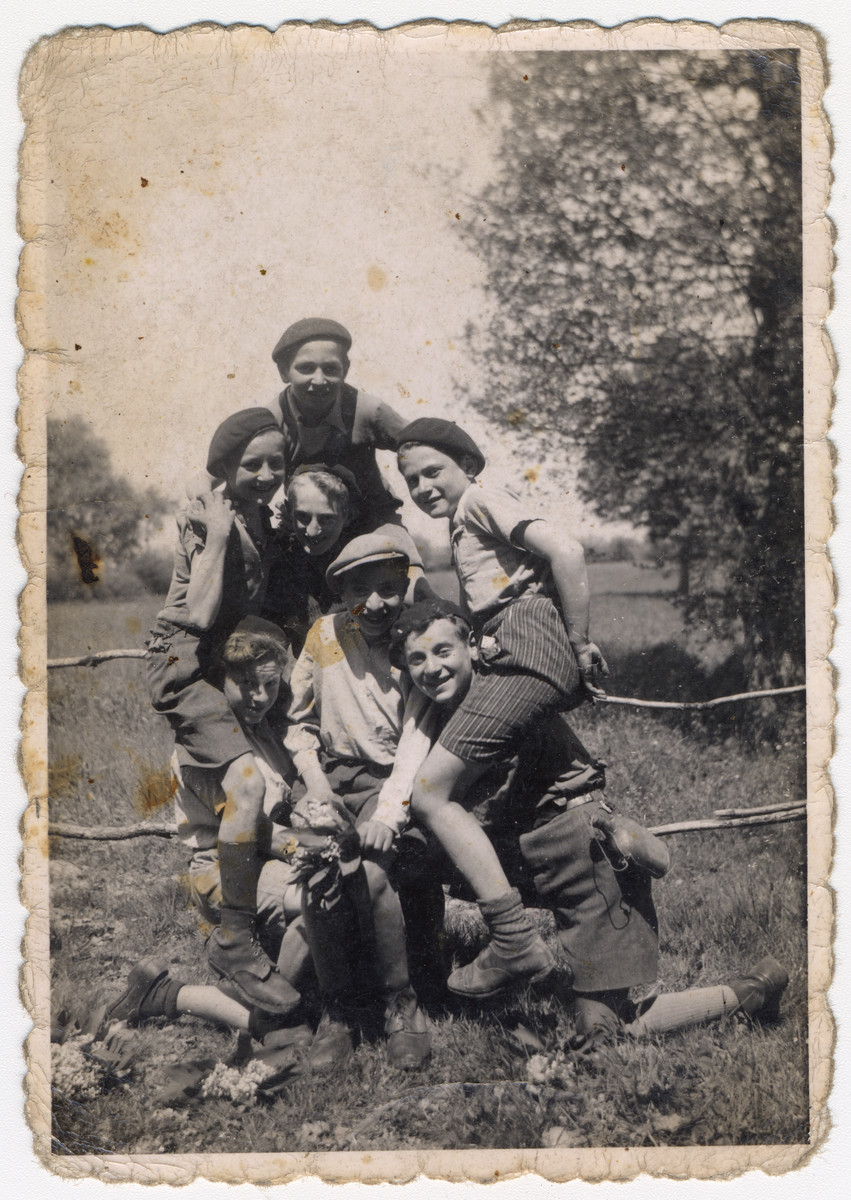 Boys in the Chateau des Morelles children's home form a human pyramid.