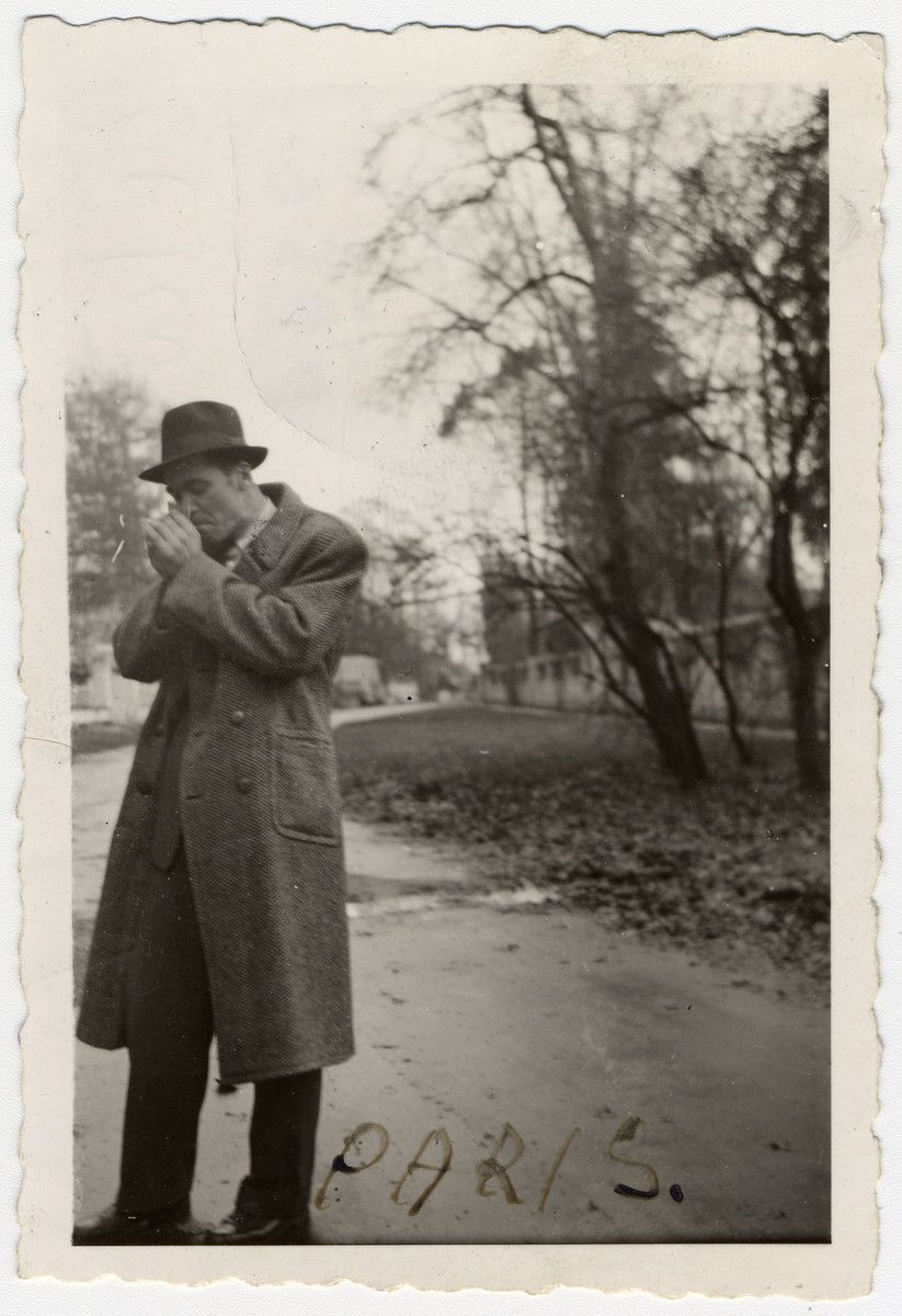Bela Rosenthal lights a cigarette on the grounds of the Barbizon children's home.
