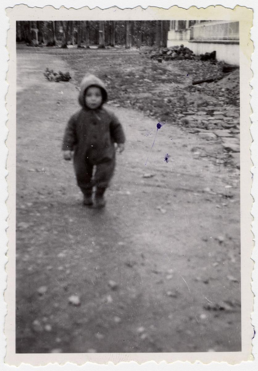 Leslie Rosenthal walks down a path outside the Barbizon children's home.