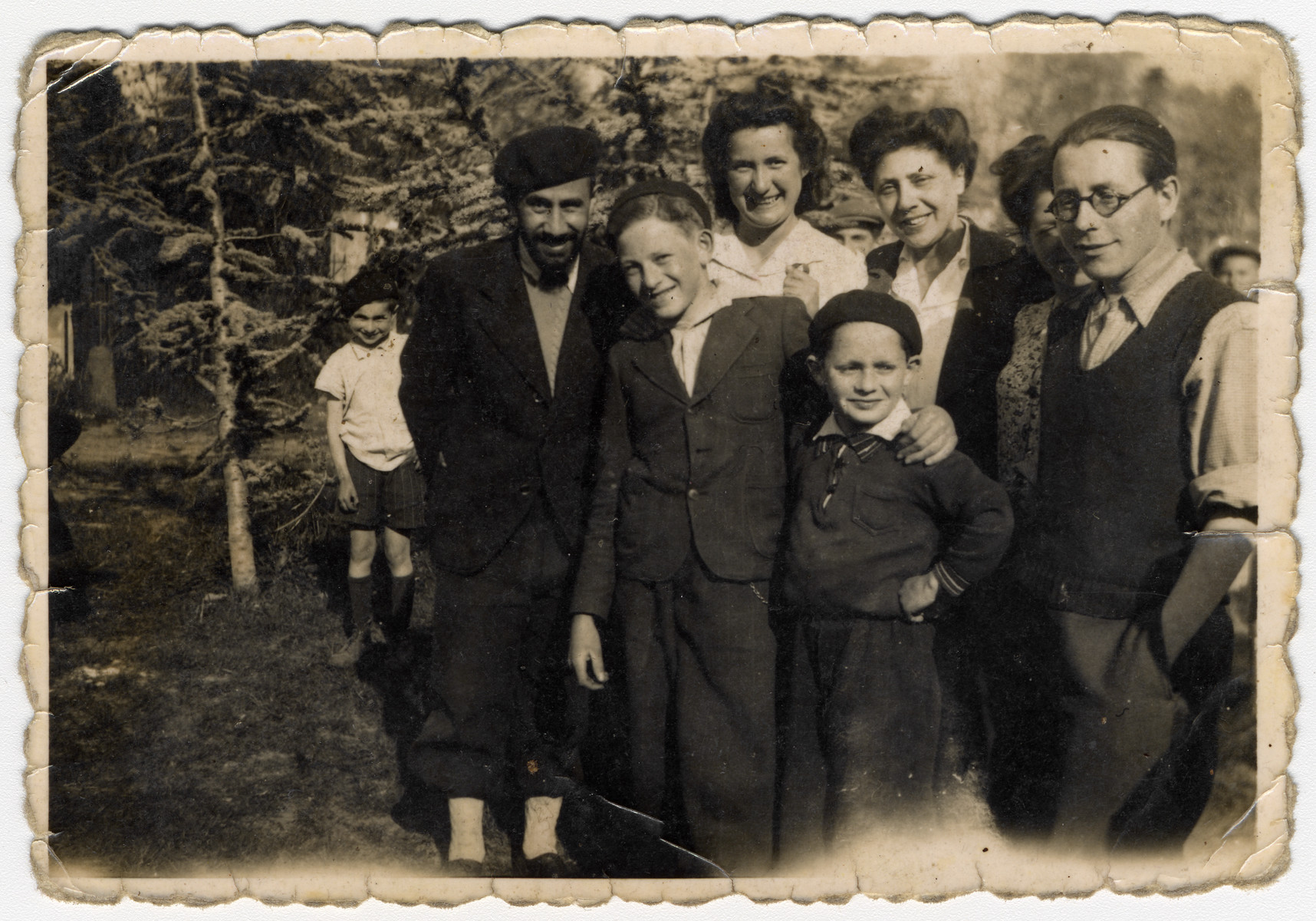Group portrait of staff and children from the Chateau des Morelles children's home.  Pictured in front are Raphael and Markus Horowitz.  Standing left to right are Mr. Amsel, Myriam (Weichselbaum) Dybnis, Mrs. Brown, and [possibly Henry Dybnis].