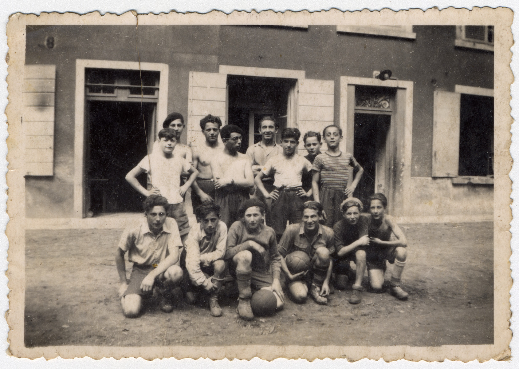 Group portrait of boys from the Chateau des Morelles children's home.