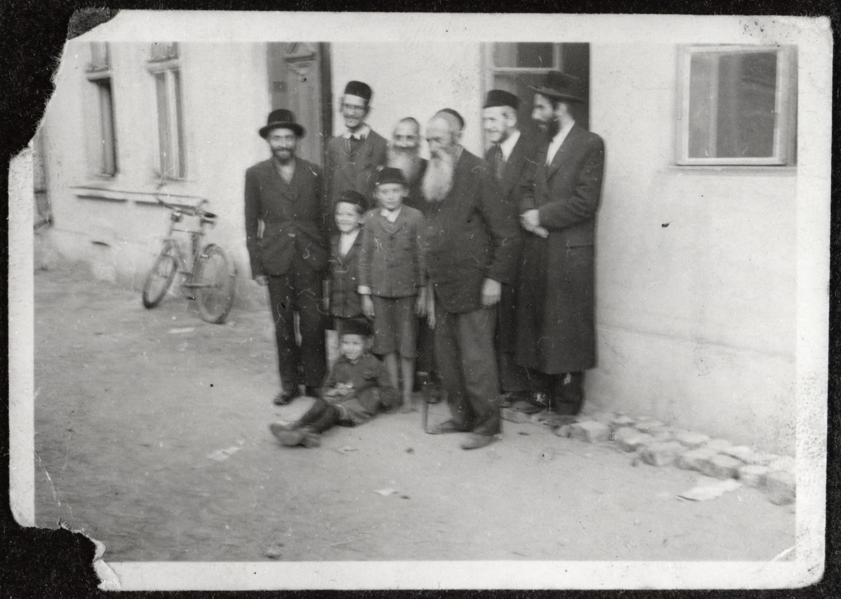 A group of religious Jews pose outside a building in the Rovno ghetto.