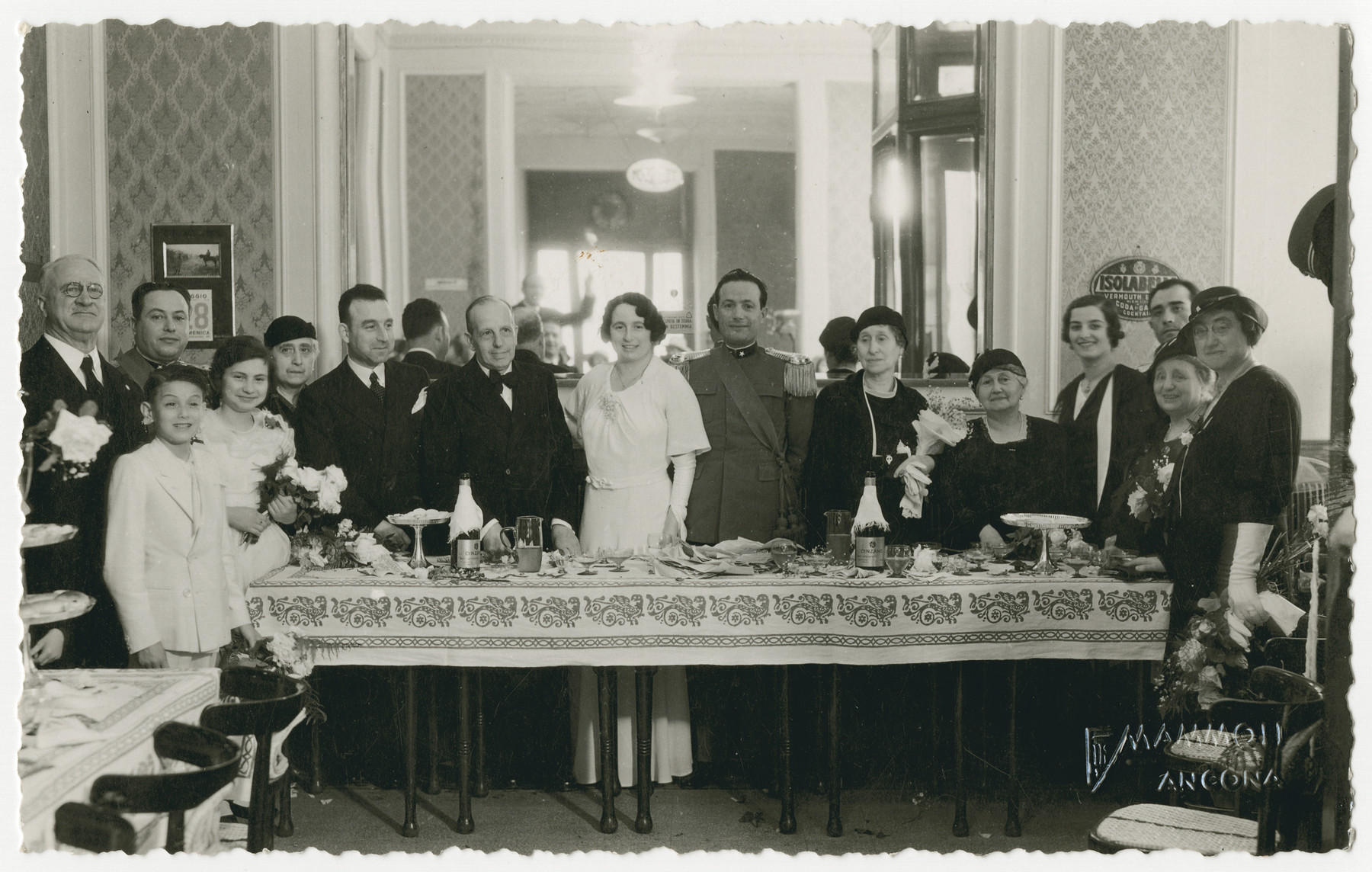 The Nacamu family celebrates a wedding,  Clotilde Coen Nacamu (1866-1958) is standing fifth from the right,.