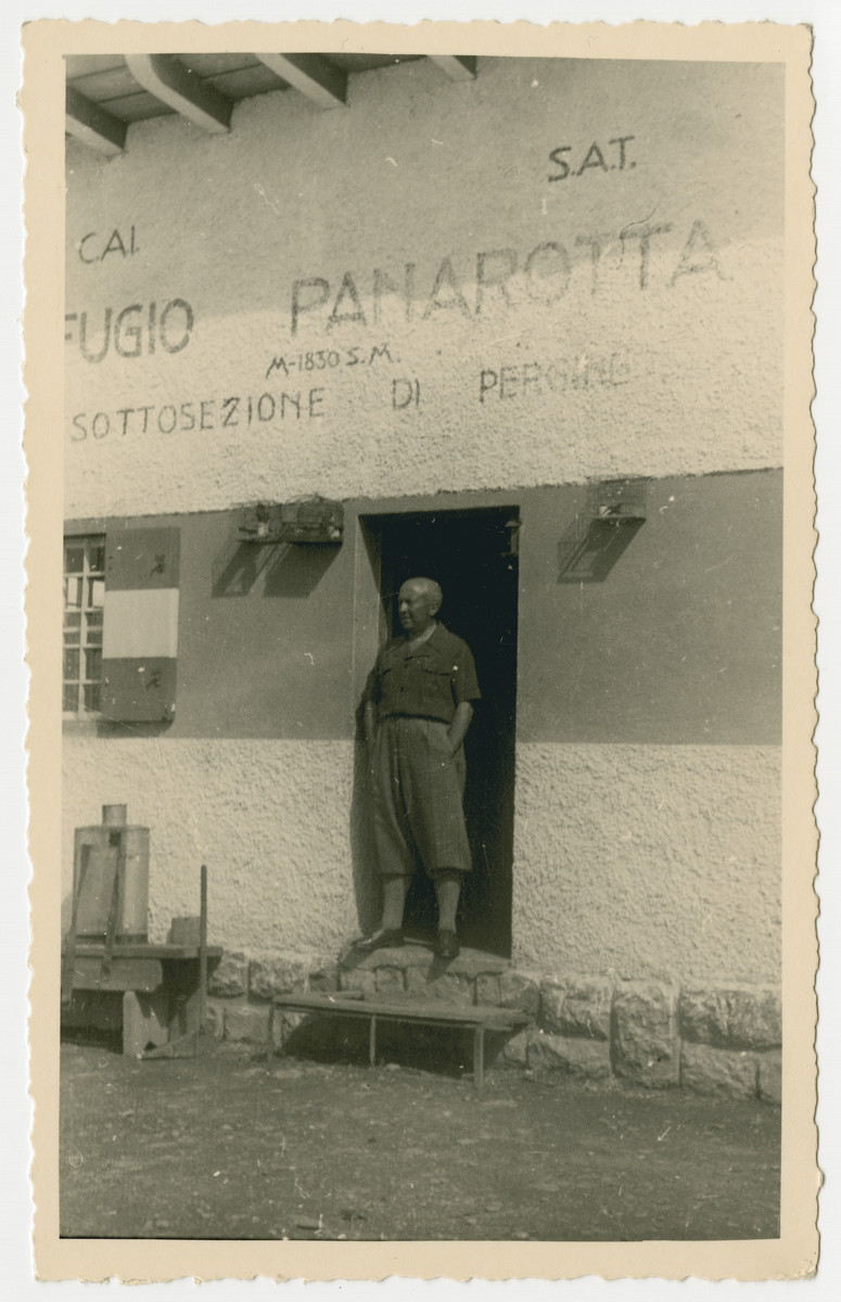 Oscar Nacamu poses in front of Rifugio Panarotta, an alpine  skiing hut, while on vacation at  in Levico Terme.