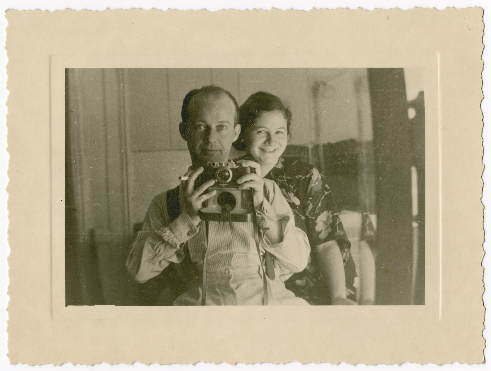 Portrait of Guido Nacamu posing with his camera and his wife Lisl Meier Nacamu.  Guido was from Ancona, Lisl from Germany. They lived in Milan before moving to New York in 1939 due to the racial laws in Germany and Italy.