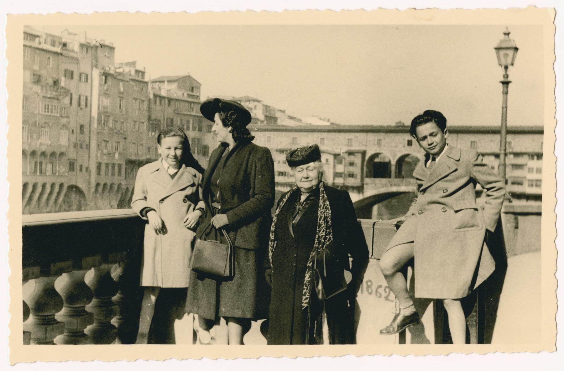 Daniele and Leonardo Nacamu visit the Ponte Vecchio with their grandmother Clotilde Coen.
