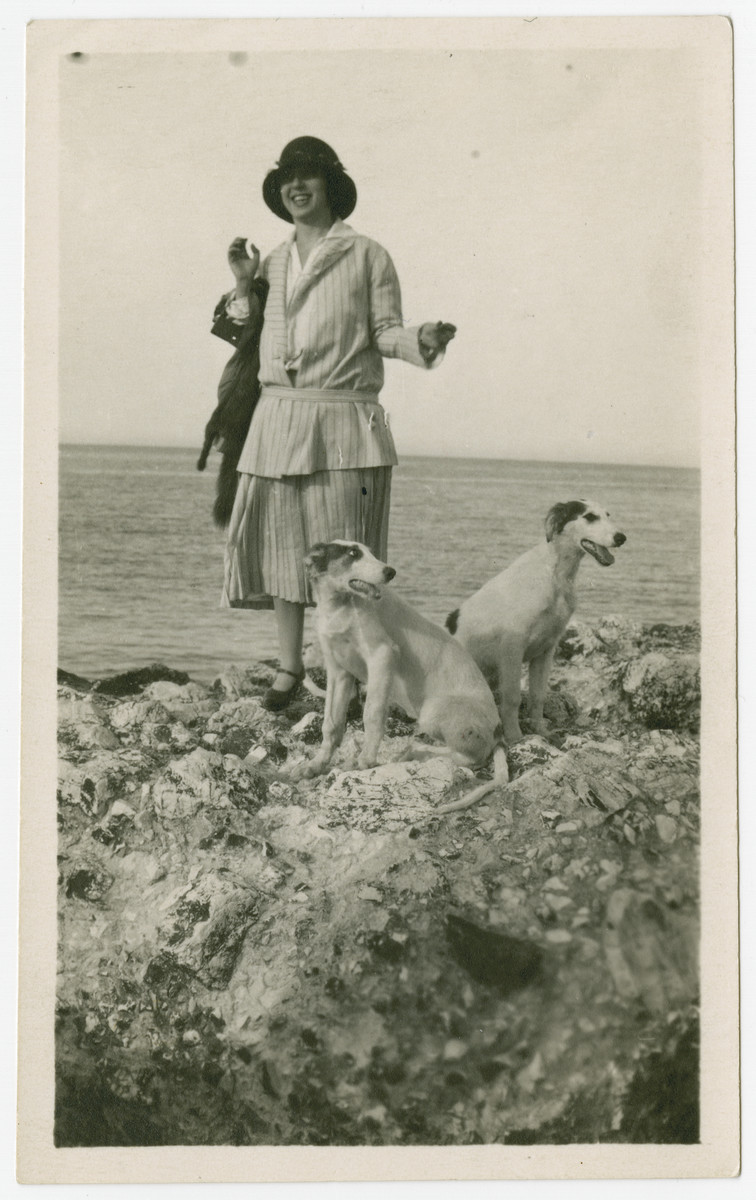 Dora Nacamu Ducly stands on the Ancona shore with her brother Oscar's dogs.