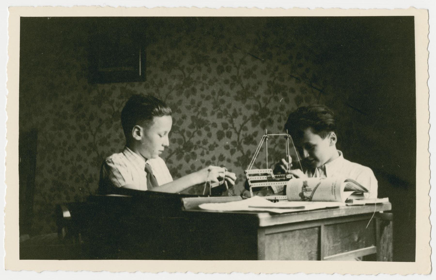 Daniele and Leonardo Nacamu play with a Meccano construction set in their home in Bologna.