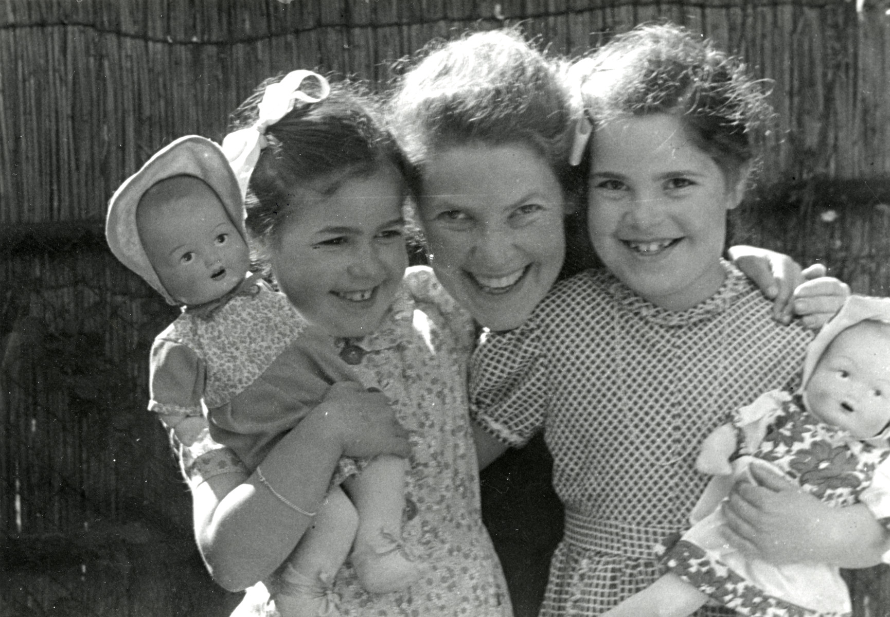 Eva Tikotin hugs her two young daughters, Johanna and Leentje, prior to their going into hiding.  She gave Leentje this photograph to take with her into hiding so that she would remember her mother, but Leentje had to give it up for security reasons.