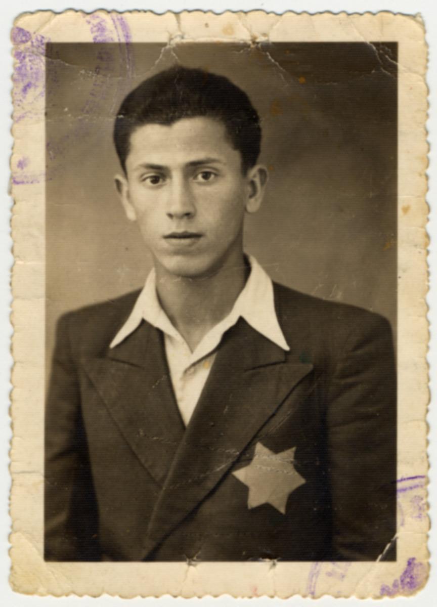 Studio portrait of Erno Pollak wearing a Jewish star.