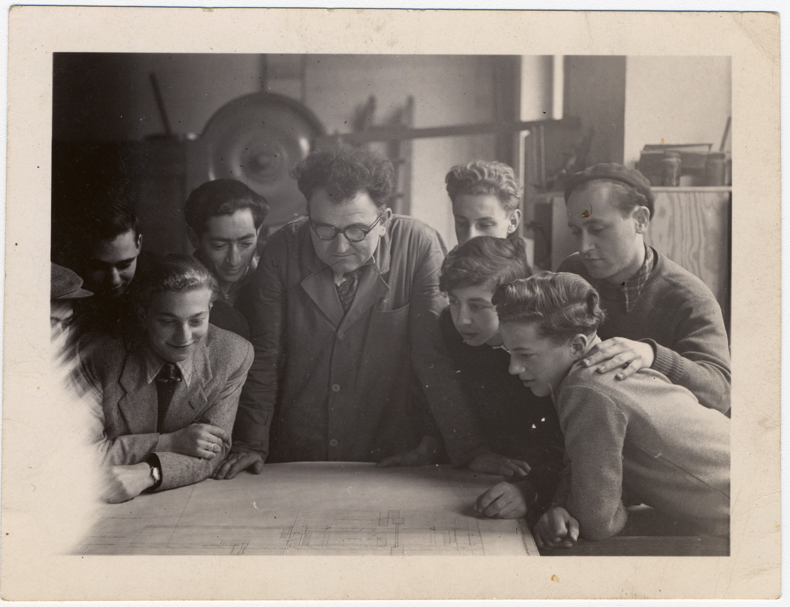 Jewish youth gather around a workshop table in an ORT vocational school in Geneva.  Those pictured include Alex, Bernard. Mr. Radice, Hermann and Moshe.