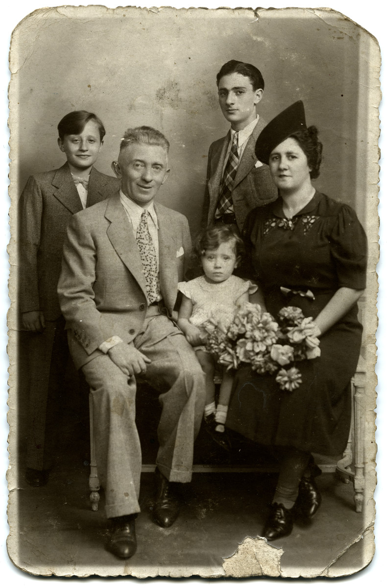 Studio portrait of the Alkalai family, Bulgarian Jews in France.  Pictured are Benjamin and Emilie Alkalai and their three children Richard, Henri, and Jacqueline.