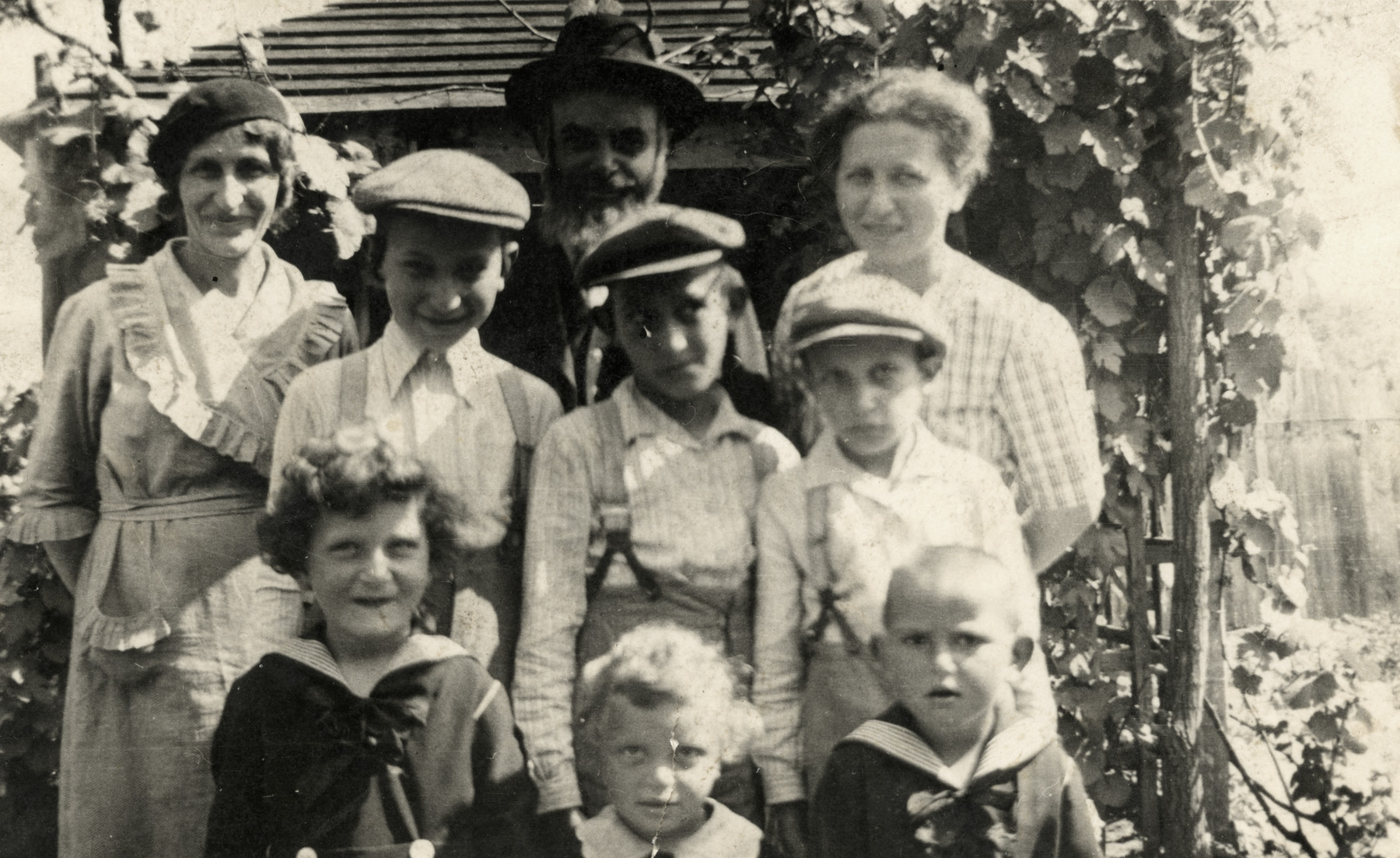 Prewar portrait of the Teichman family in Kisvarda, Hungary.  From left to right (bottom row): Yehudit, Tzipora and Sarah.  Standing: Yosef, Ephraim and Avigdor.  Back row: Piroska Teichman, Moshe Teichman and Aunt Tova.