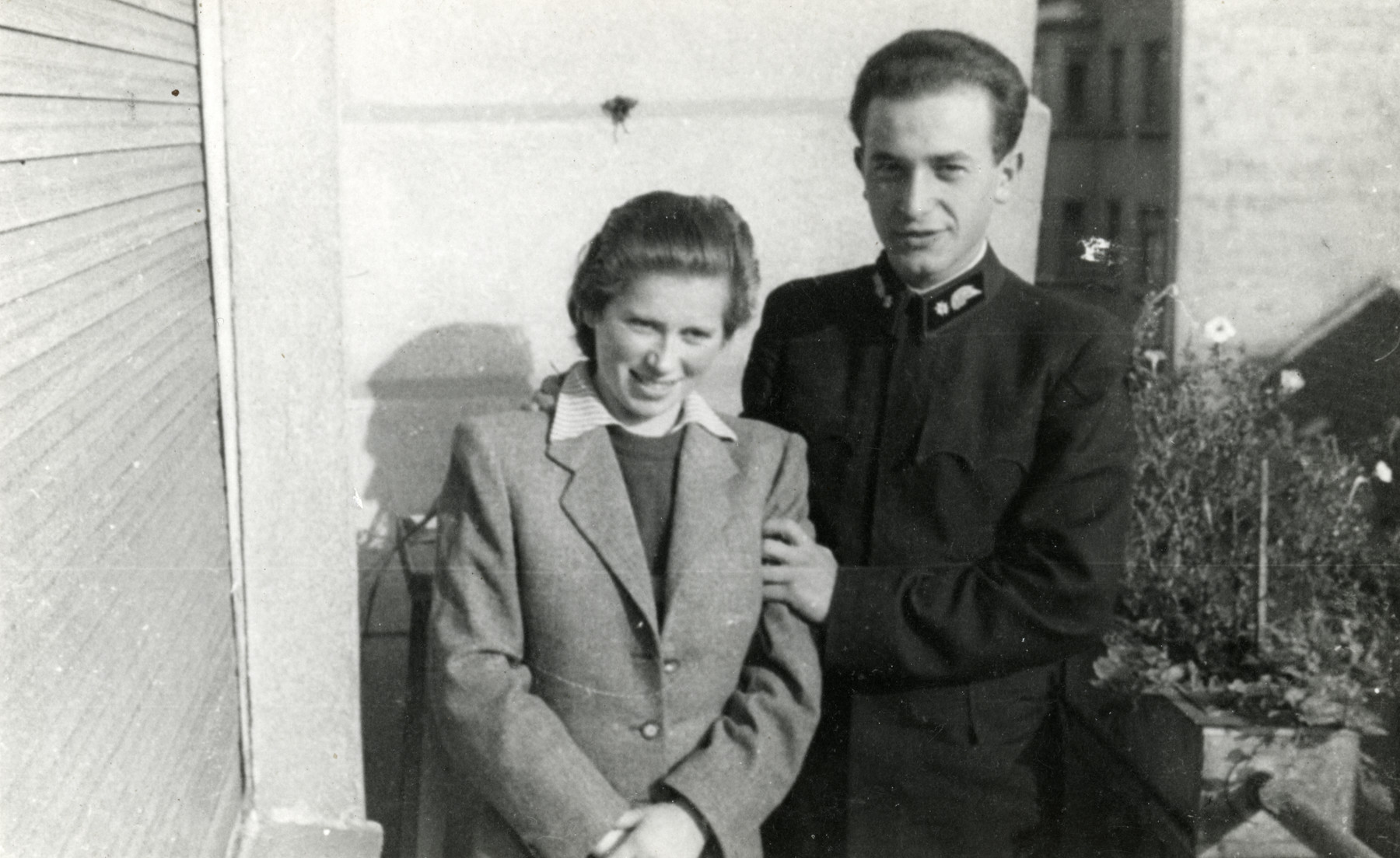 Portrait of Ephra Teichman and Tzippora Schaechter, two leaders of the Zionist resistance, rescue group in Hungary.  Ephraim Teichman is wearing the uniform of a train engineer (his wartime alias).  The photograph was taken either shortly before or shortly after the two wed.