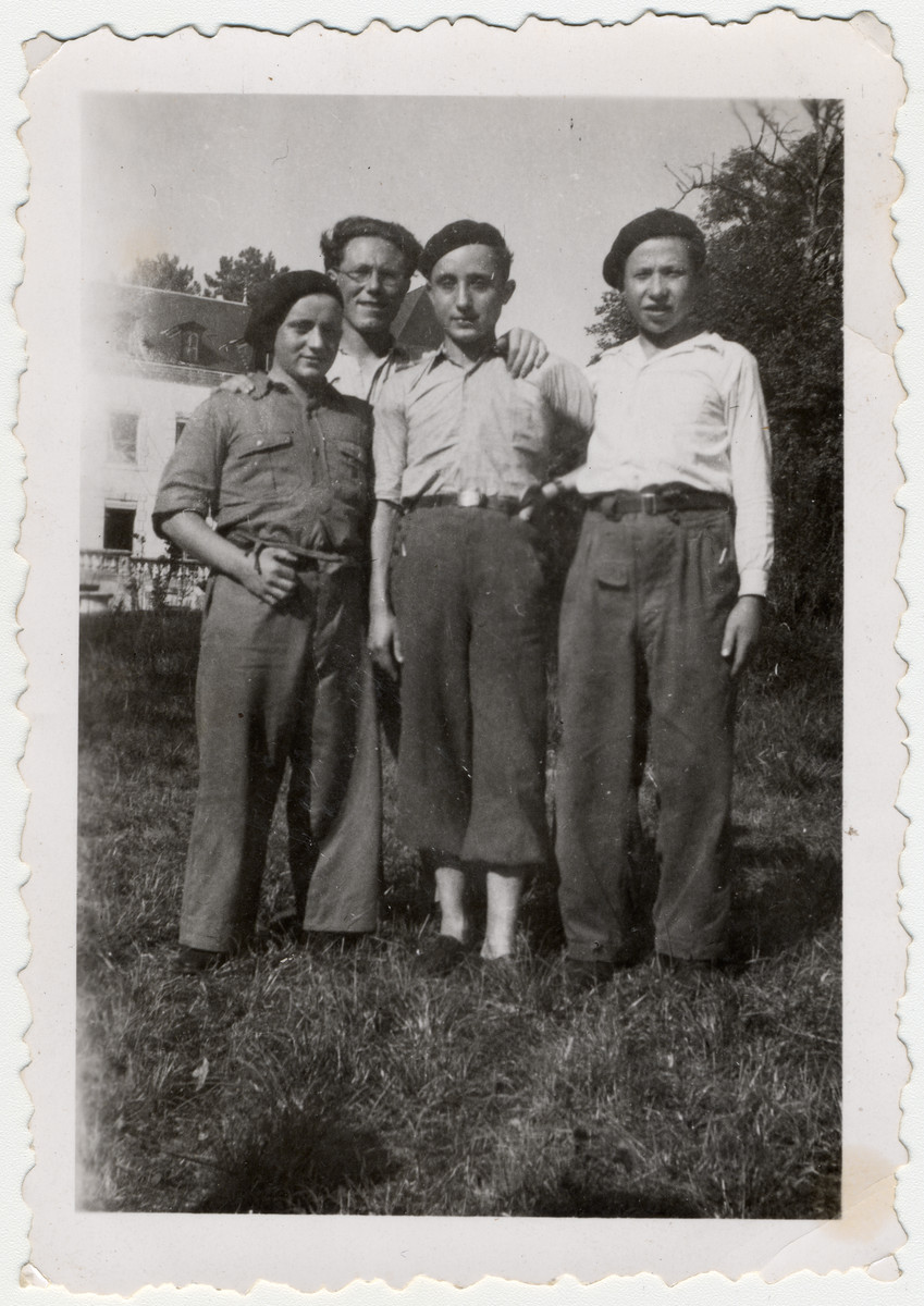 Portrait of three teenage boys and a counselor in the OSE home of either Ambloy or Taverny.  Pictured are Kalman Kalitsky and the teacher Michel Fredman.