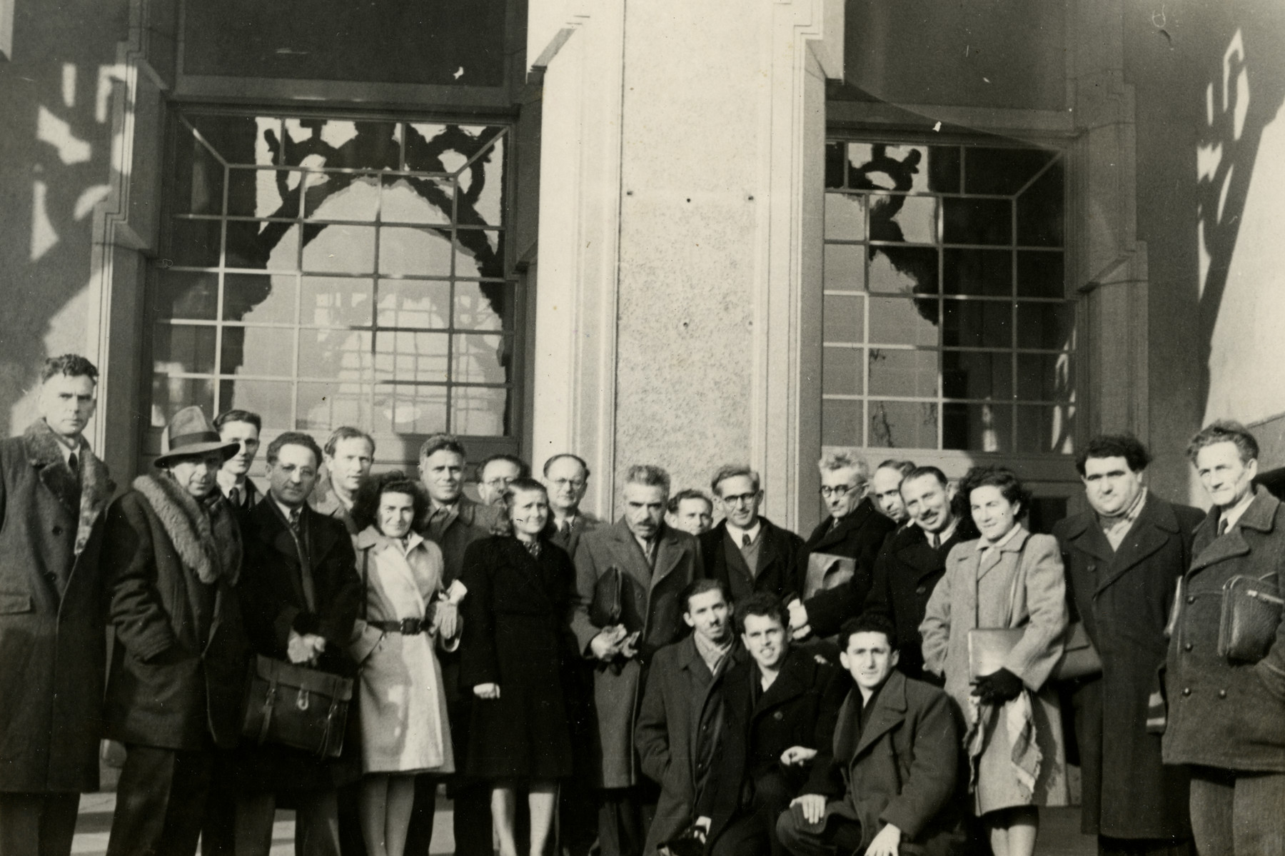 Group portrait of members of the 22nd Zionist Congress in Basel.  Among those pictures are Chana Rubin (far left), Josef Jambor (fourth from left), Haika Grosman (standing center-left in black coat), Meir Yaari (kneeling center left) and Julek Barzilai.
