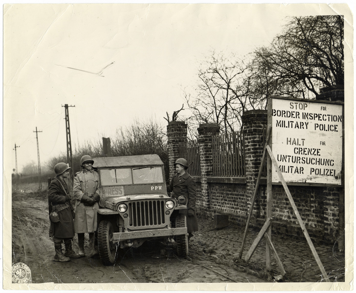 Joseph W. Eaton and Mr. C.W. Kingdon passing the border of Germany on their way to make a reportage on Christmas in Germany in 1944.   They interviewed German POWs and broadcast their greetings back to their families on Radio Luxembourg.
