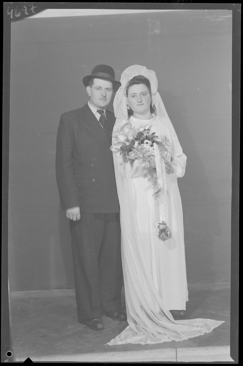 Studio wedding portrait of Abraham Junger and his bride.