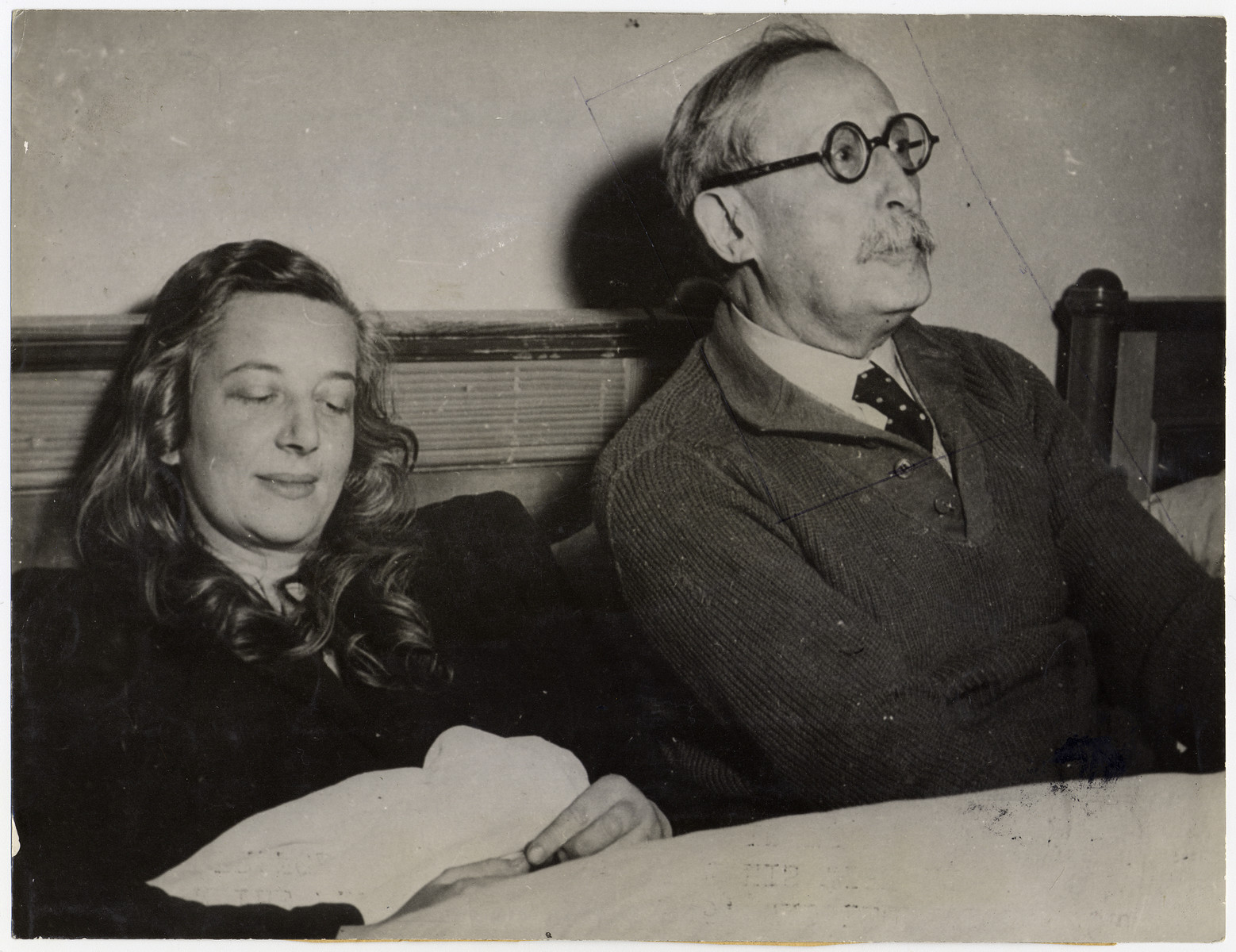 """Portrait of former French Prime Minister Leon Blum and his wife, following their liberation.  Original caption reads: """"Among the famous personalities freed by Allied troops from the German concentration camp at Lago di Braies in the Alps, in Italy, on May 4, 1945, was Leon Bloom, former Prime Minister of France, who is shown with his wife at the camp. Blum disclosed that he had been a prisoner in France until March, 1943, when the Gestapo took him to Germany with Deladier and General Gamelin. Confined at Buchenwald, he was guarded by 20 SS men with especially trained police dogs. Later he was taken to the Alpine camp for perpetual confinement, without having a trial. Although suffering from lumbago and bronchitits, Blum shook hands energetically with his Liberators. During five years of imprisonment, Blum and his wife listened secretely to BBO broadcasts."""""""