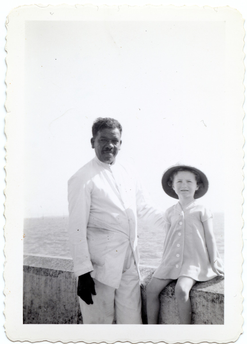 Joanna Klein poses with an Indian man in Bombay while en route to the United States with her parents from Nazi occupied Poland.
