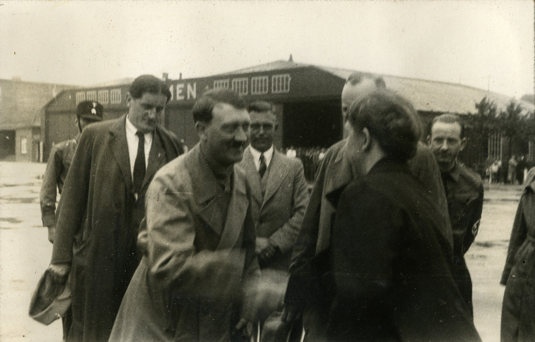 "Adolf Hitler greets friends before leaving the airport in Bremen, Germany, 1932.  Original caption on album page reads, ""Hitler. Germany 1932."" Photo-specific caption reads, ""Bremen, Germany 1932. Greeting pals & friends before leaving airport."""