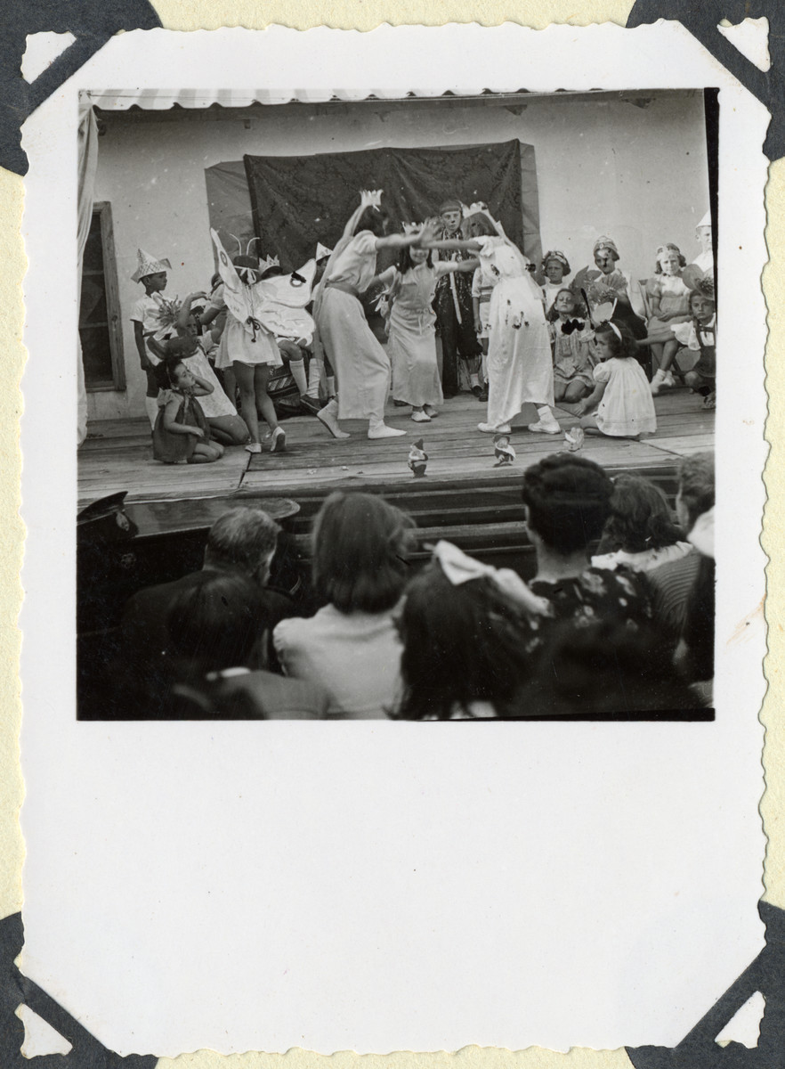 Children in the Ferramonti internment camp perform Snow White in a play written by Hella Mayer.