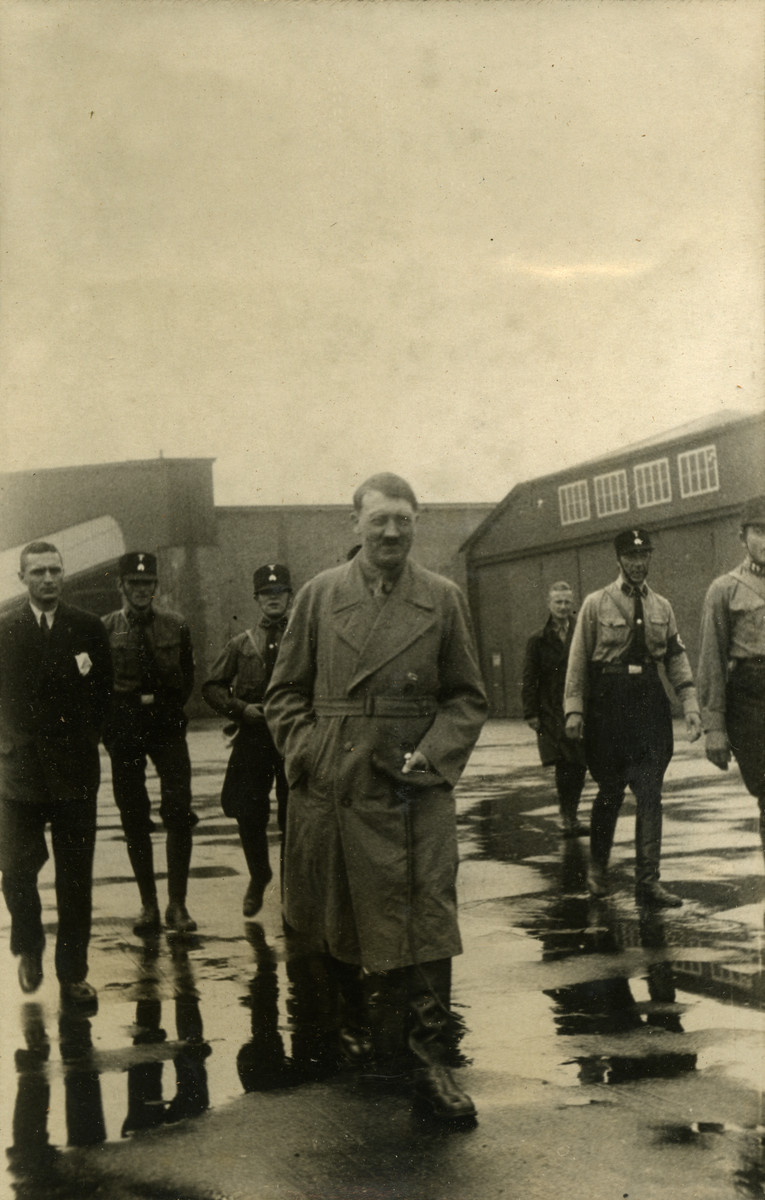 "View of Adolf Hitler leaving the airport in Bremen, Germany , 1932.   Original caption on album page reads, ""Hitler leaving the airport field, Aug. 1932."" A secondary caption reads, ""Hitler the leader. 1932, Germany. Bremen Airport."""