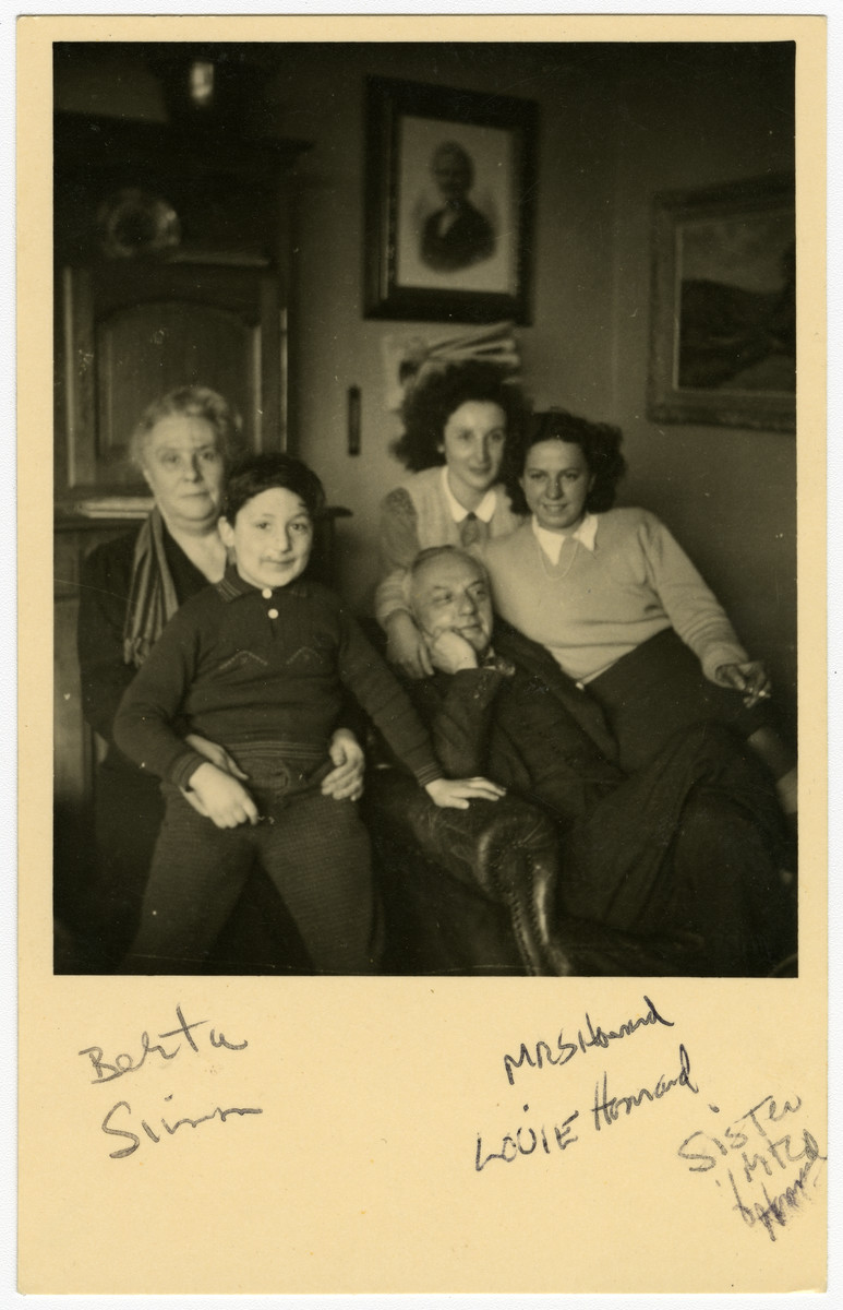 Simon Steil poses with his rescuers, Bertha and Jules Henrards and their daughers.