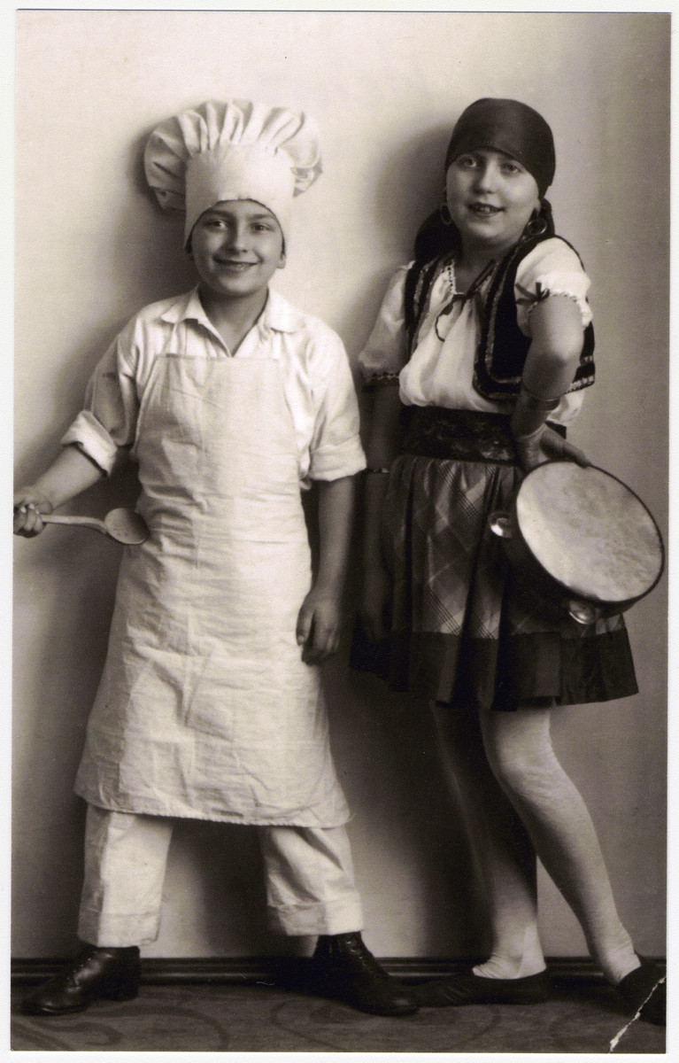 Hans and Ilse Hanauer dress up as a chef and a traditional musician.