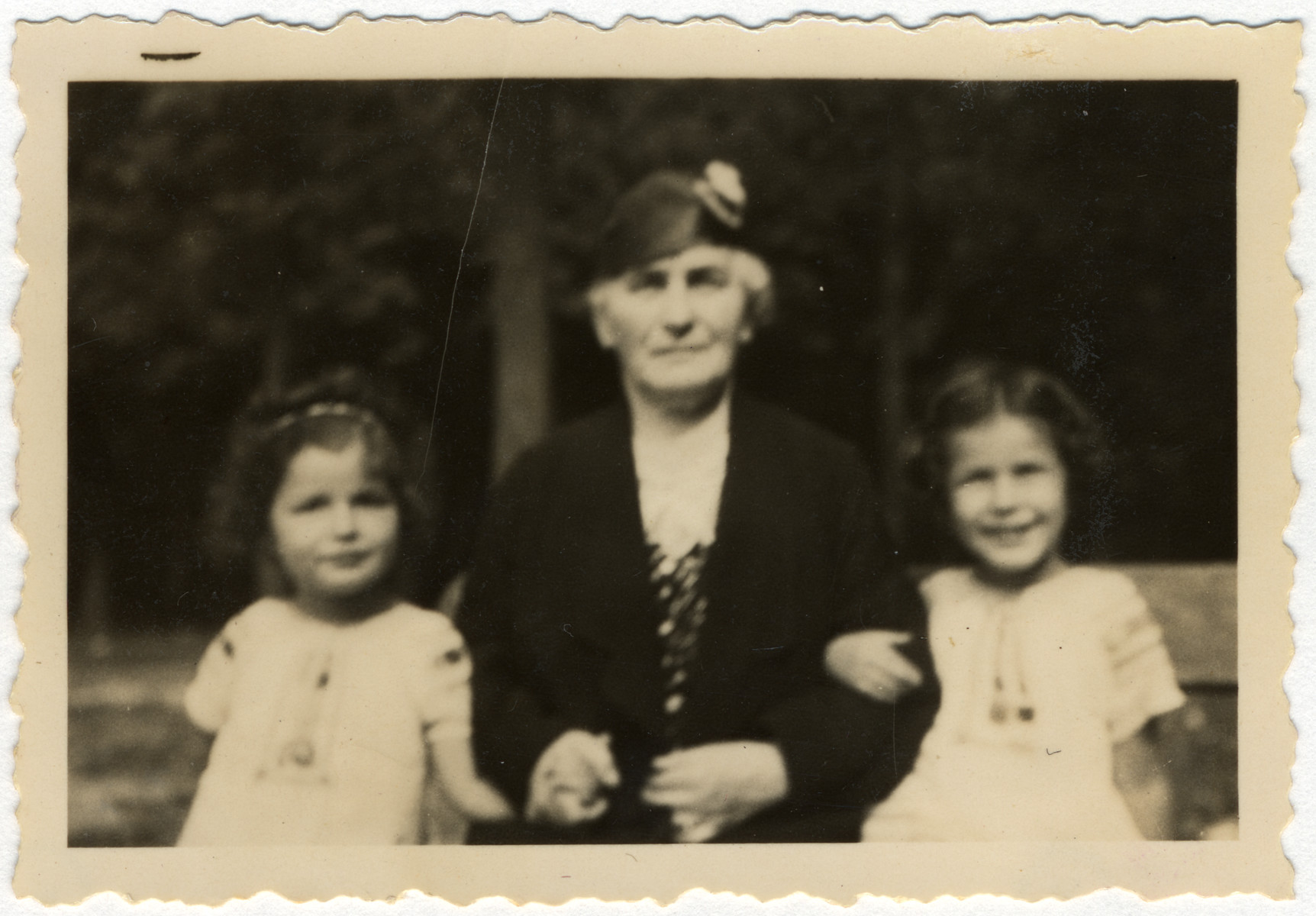 Jacqueline (left) and Manuela Mendels (right) go for a walk with their paternal grandmother, Thekla Marx Mendels.  Their grandmother later perished in Sobibor at the age of 70.