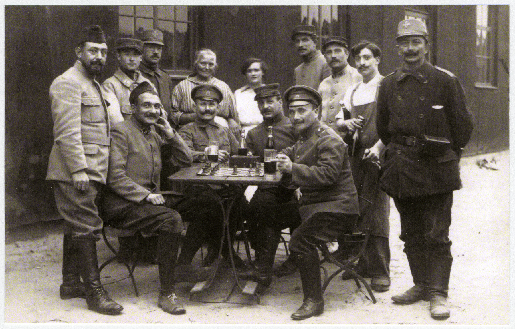 Max Hanauer stands at the far right with Russians playing chess during WWI.