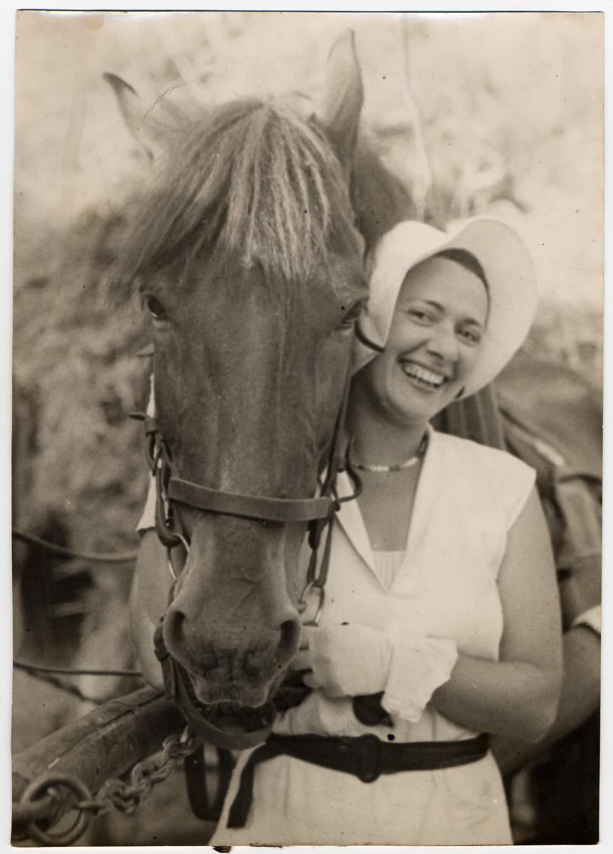Greta Stoessler Engel stands next to her horse in prewar Austria.