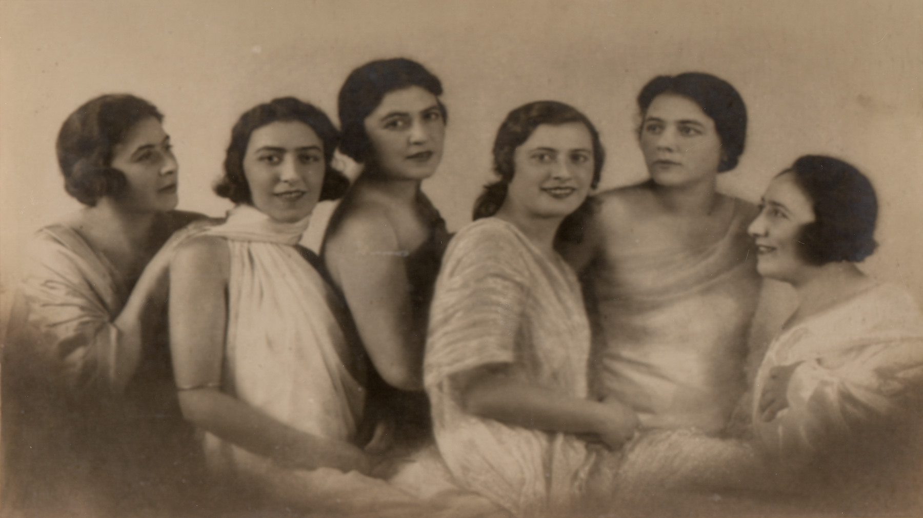 Studio portrait of the Stoessler sisters, a prosperous Austrian-Jewish family.   Pictured from left to right are Frida, Erna, Stella, Greta, Emma and Vali.