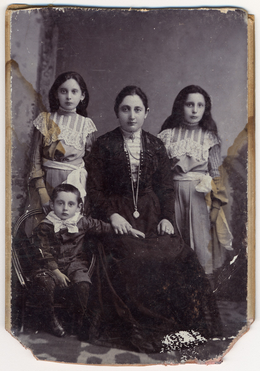 Studio portrait of Berta nee Pollack Engel surrounded by her children Ludwig (age 5), Olga (later Breuer) and Manci.