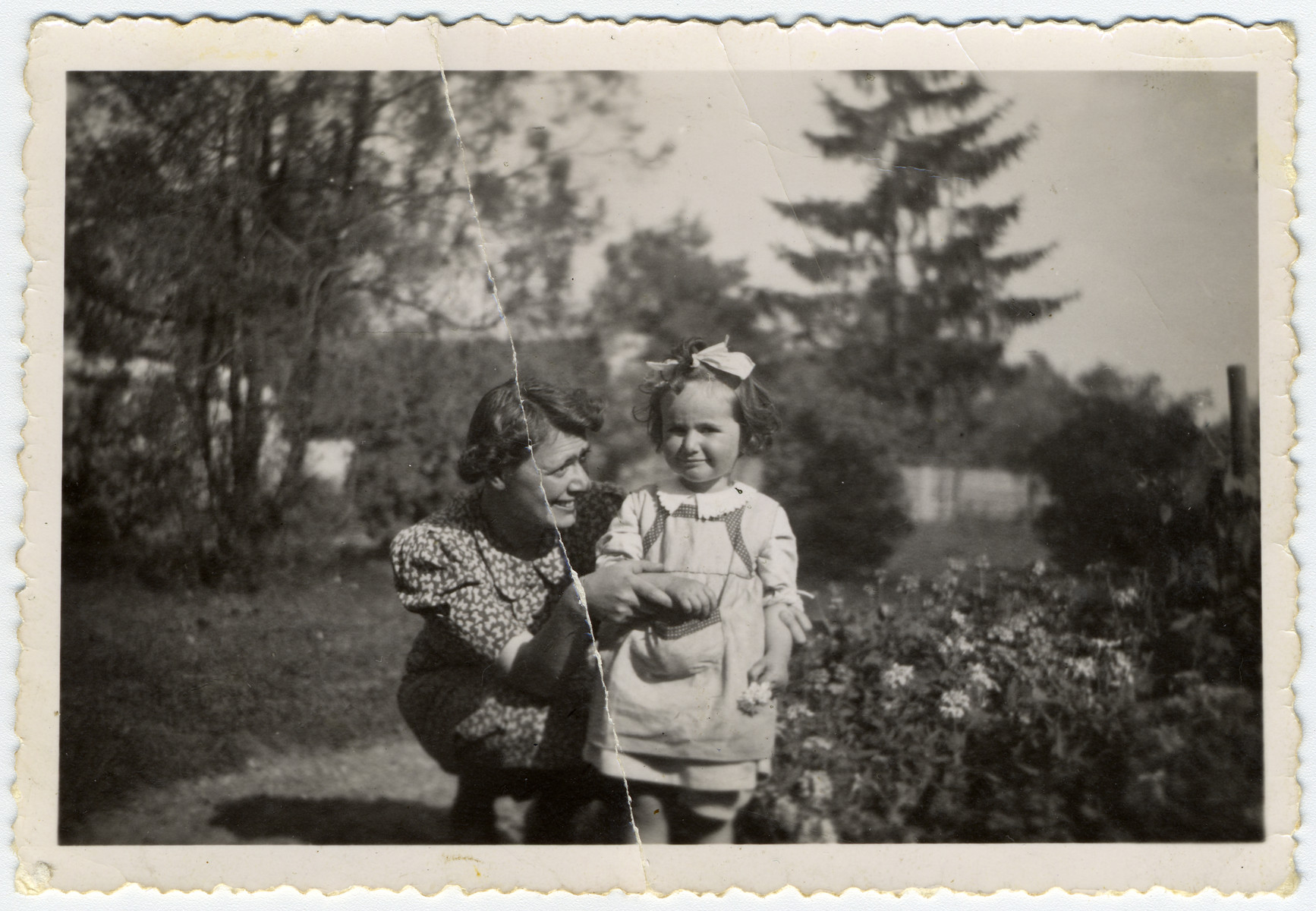 Katie Engel stands with her mother on her uncle's farm in Czechoslovakia.