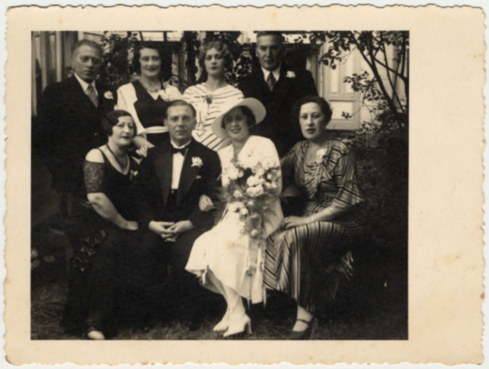 Wedding portrait of a Latvian Jewish family.  Seated from left to right are: Erna Taub Schwab (wife of Leo Schwab), Gustav Smitkowski, the bride Raja Taub Smitkowitzi, and another Taubchen Taub .  Klara and Arkadi Jakob Schwab are standing in the back right.