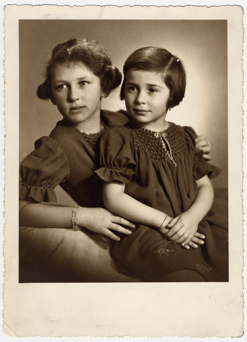 "Studio portrait of Ellen and Margit Seligman.    The inscription on the back of the photograph reads, ""Ellen & Margit, Jannar 1938."""