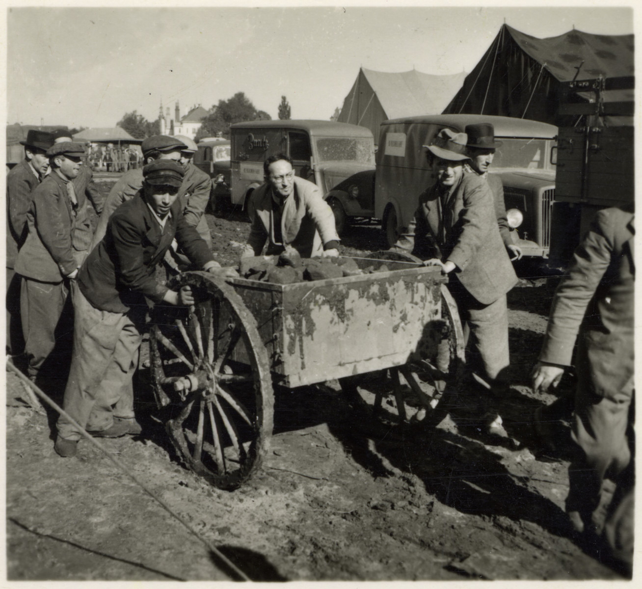 "Propaganda photo showing Polish Jews hauling a cart with stones or sod.  The original caption reads: ""Polish Jews at work to which they are not accustomed.""  The photograph was part of a series of stereographic prints depicting the occupation of Poland entitled ""Die Soldaten des Fuehrers im Felde.""  (The Fuhrer's soldiers in the field.  The photographs were mass produced and published by Raumbild-Verlag-Otto Schönstein."