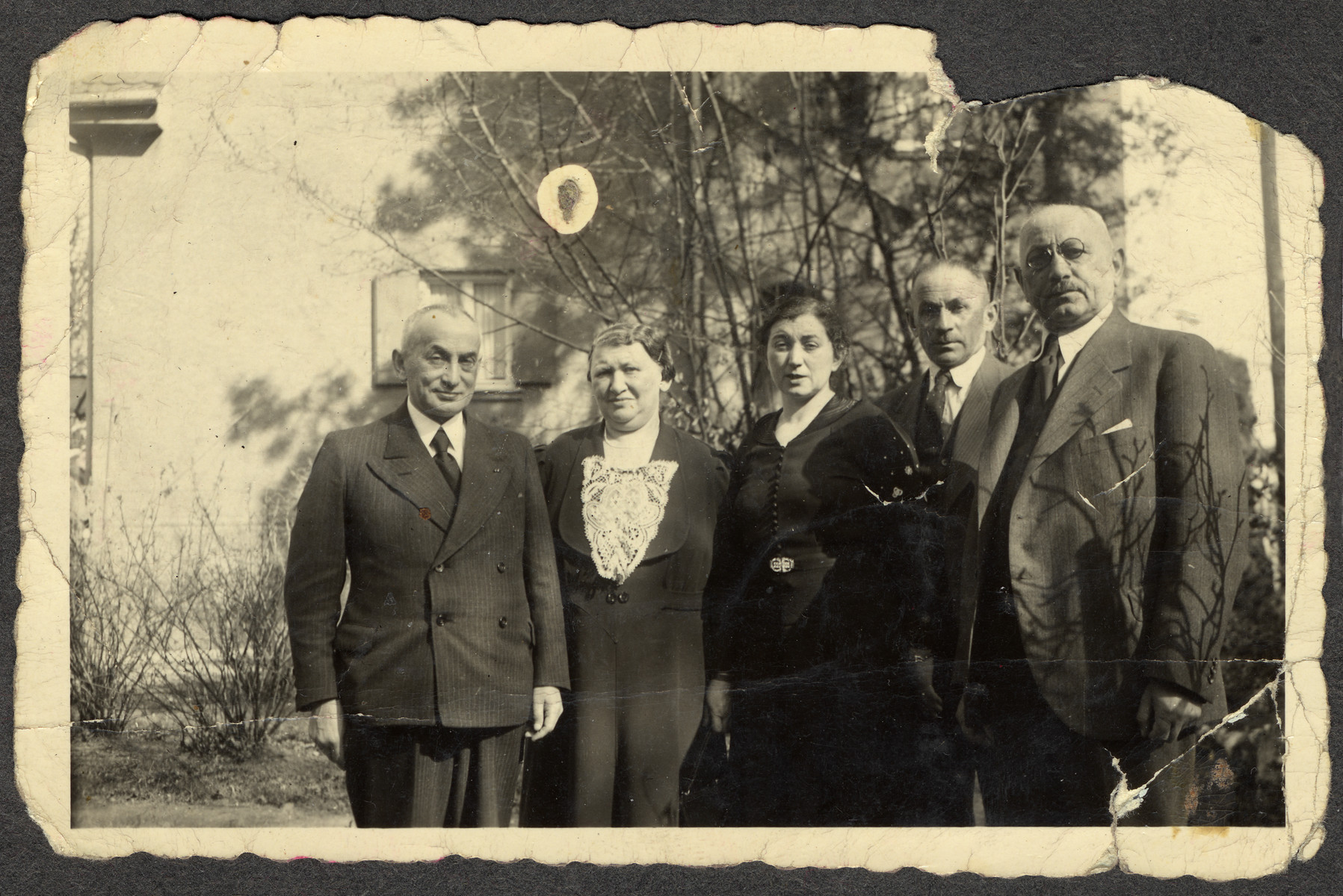The Hirschfeld and Einstein families pose for a photograph.    Pictured are Ellen Seligman's maternal grandparents, the parents of her cousin Liesel Fischer, and an uncle.  The grandparents immigrated to the United States, but members of the Einstein family perished in the Holocaust.