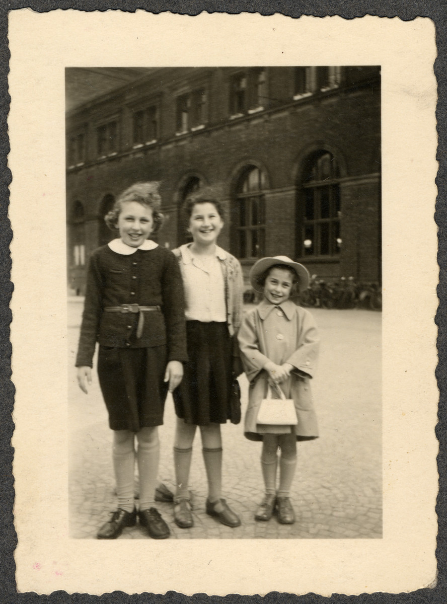 Three Jewish children at a German train station.  Pictured are Ellen Seligman, her best friend Edith Schuld, and Ellen's sister Margit.  The photograph was taken on the occasion of the visit of Ellen's grandmother's aunt.  Edith and her mother perished in the Holocaust; her father survived and immigrated to  New York.