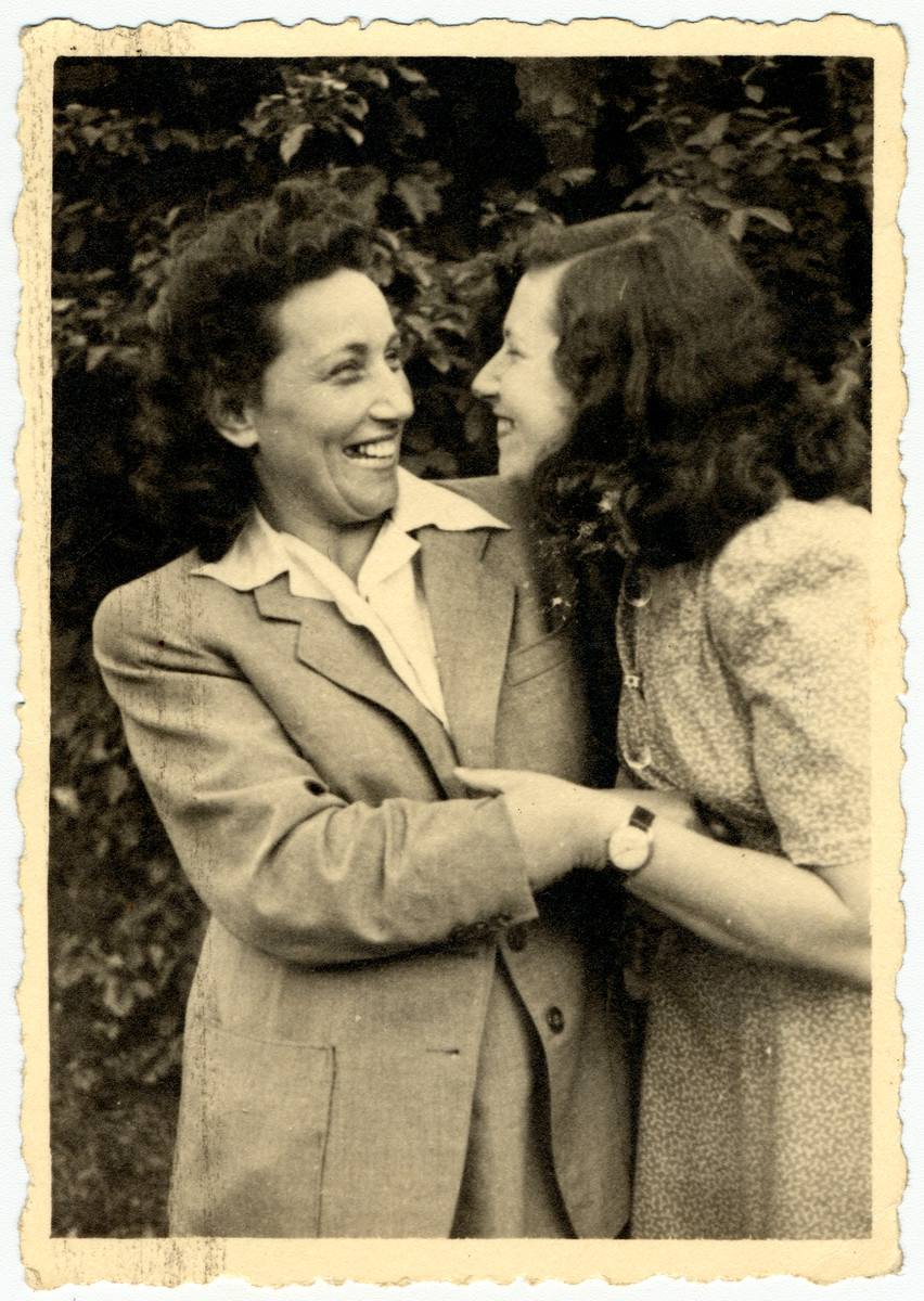 Malvina Grunfeld (left) hugs her cousin, Freidu, while in the Leipheim displaced persons' camp.