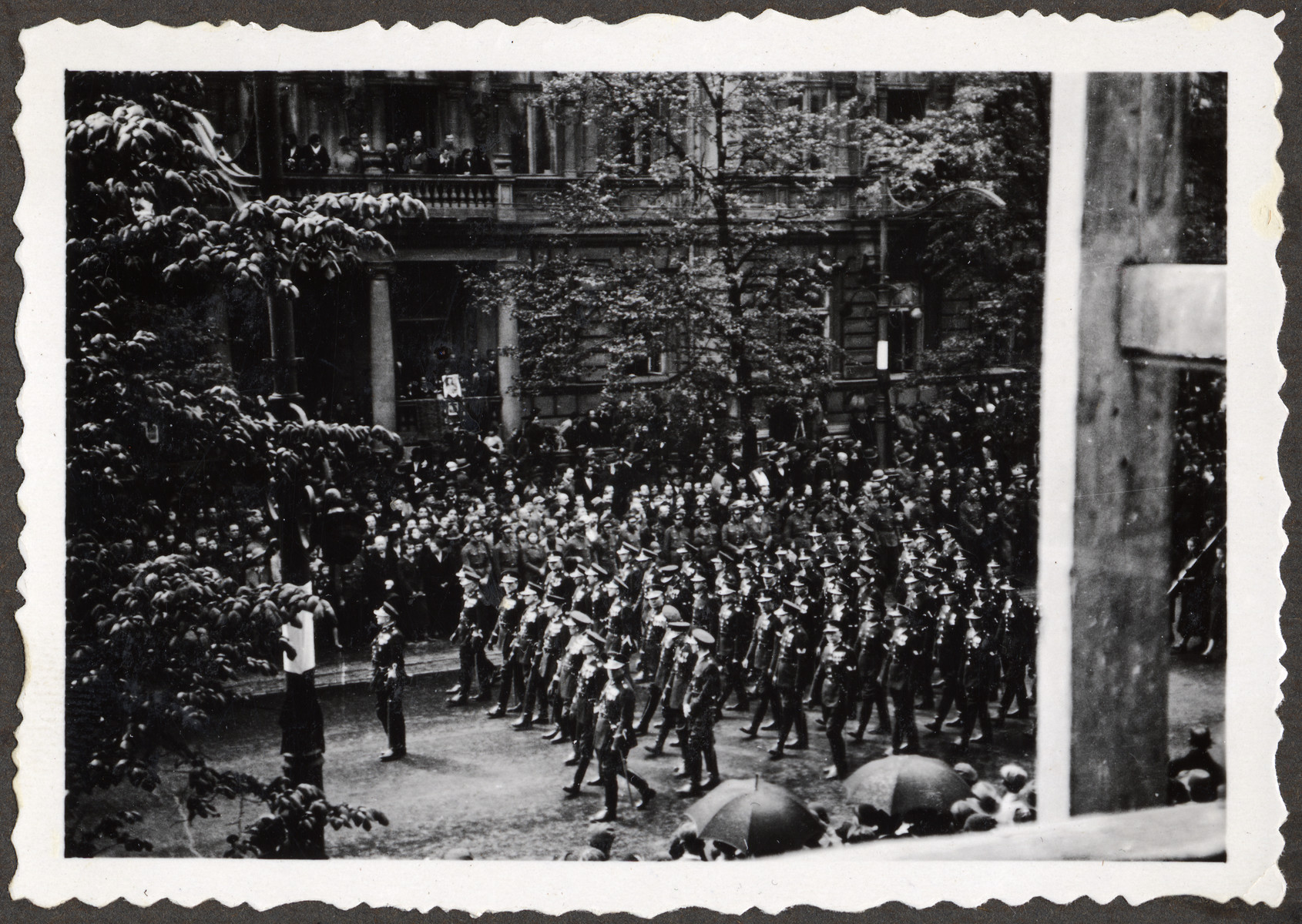 Polish soldiers march down a street in Warsaw during the funeral procession for Marshal Jozef Pilsudski.