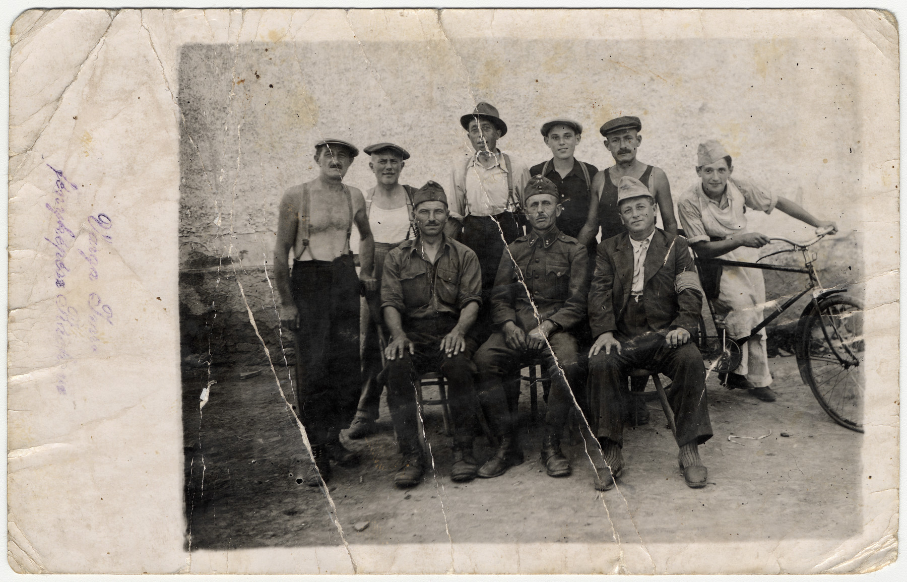 Group portrait of a Hungarian labor battalion.  Shimon Ganzl, uncle of the donor, is on the far left.