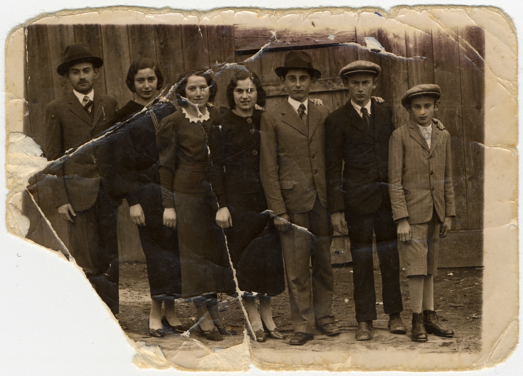 Prewar portrait of the seven Ganzl siblings.  Pictured in the center are Yitchok, Blanca and Chaya.  They immigrated to Palestine.  The others all perished.