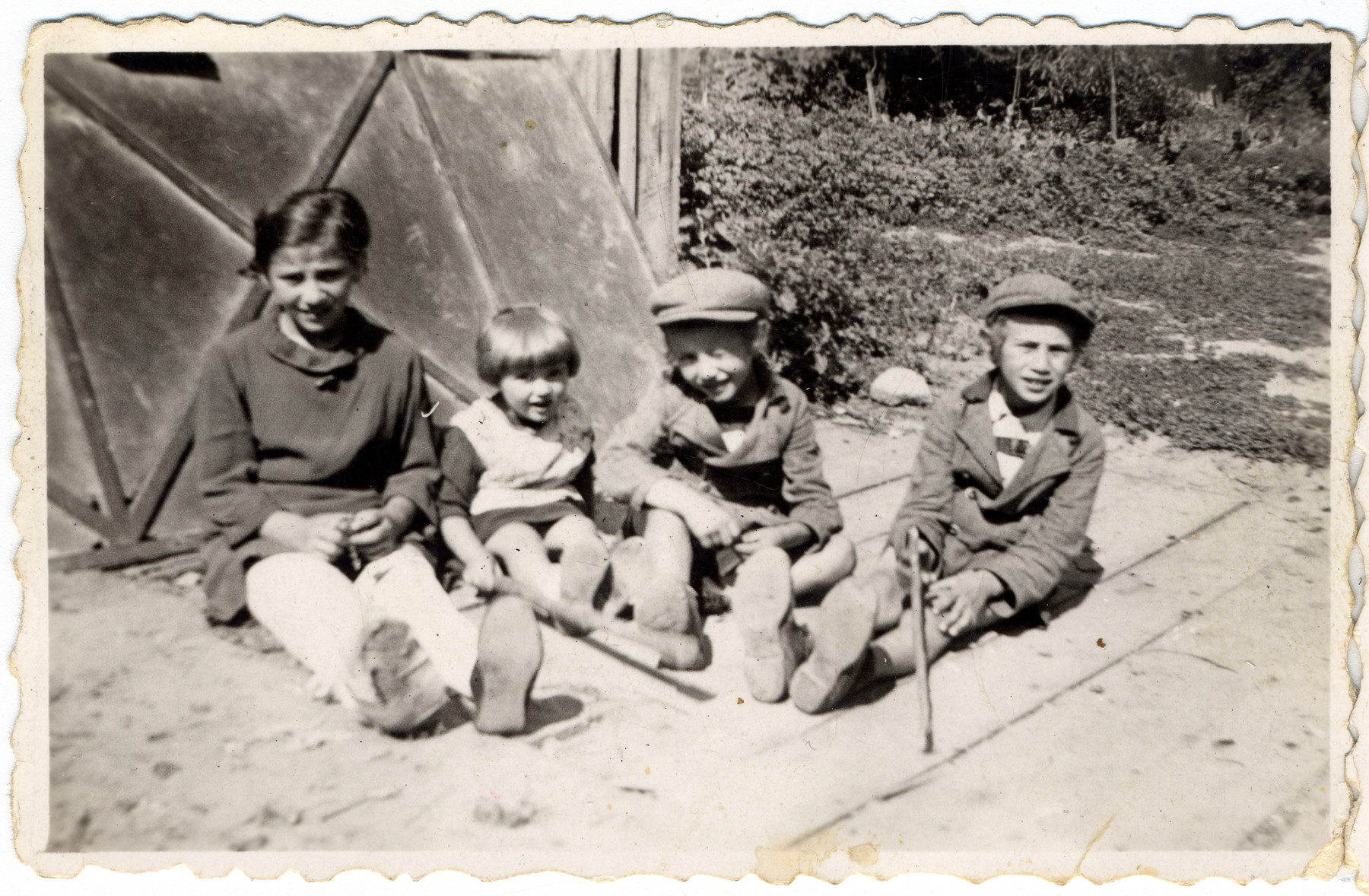 Four Weinstein children (nieces and nephews of the donor) pose outside.  All later perished in the Holocaust.  Pictured left to right are Malka, Blimcsi, Shaul, and David Weinstein.